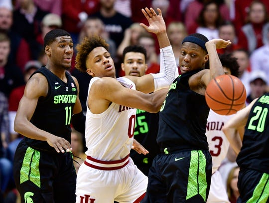 Mar 2, 2019; Bloomington, IN, USA; Indiana Hoosiers guard Romeo Langford (0) and Michigan State Spartans guard Cassius Winston (5) go for the ball during the second half of the game at Assembly Hall.The Indiana Hoosiers defeated the Michigan State Spartans at the last second 63 to 62. Mandatory Credit: Marc Lebryk-USA TODAY Sports