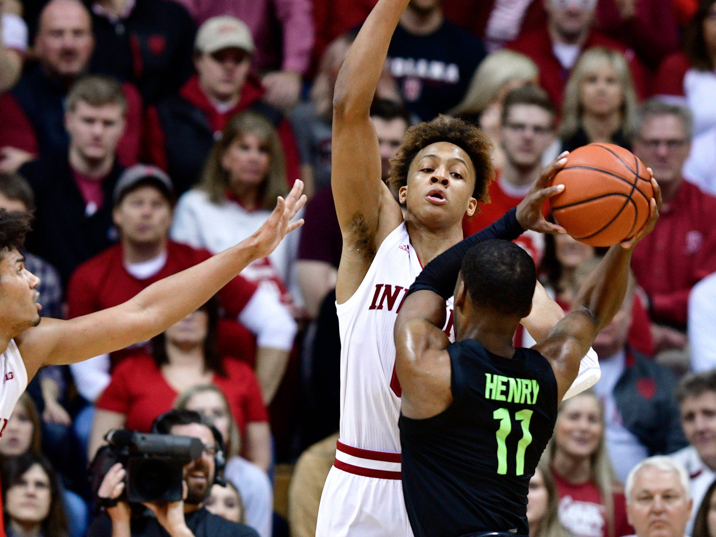 Mar 2, 2019; Bloomington, IN, USA; Indiana Hoosiers guard Romeo Langford (0) attempts to block a shot from Michigan State Spartans forward Aaron Henry (11) go after a loose ball during the first half of the game at Assembly Hall. Mandatory Credit: Marc Lebryk-USA TODAY Sports