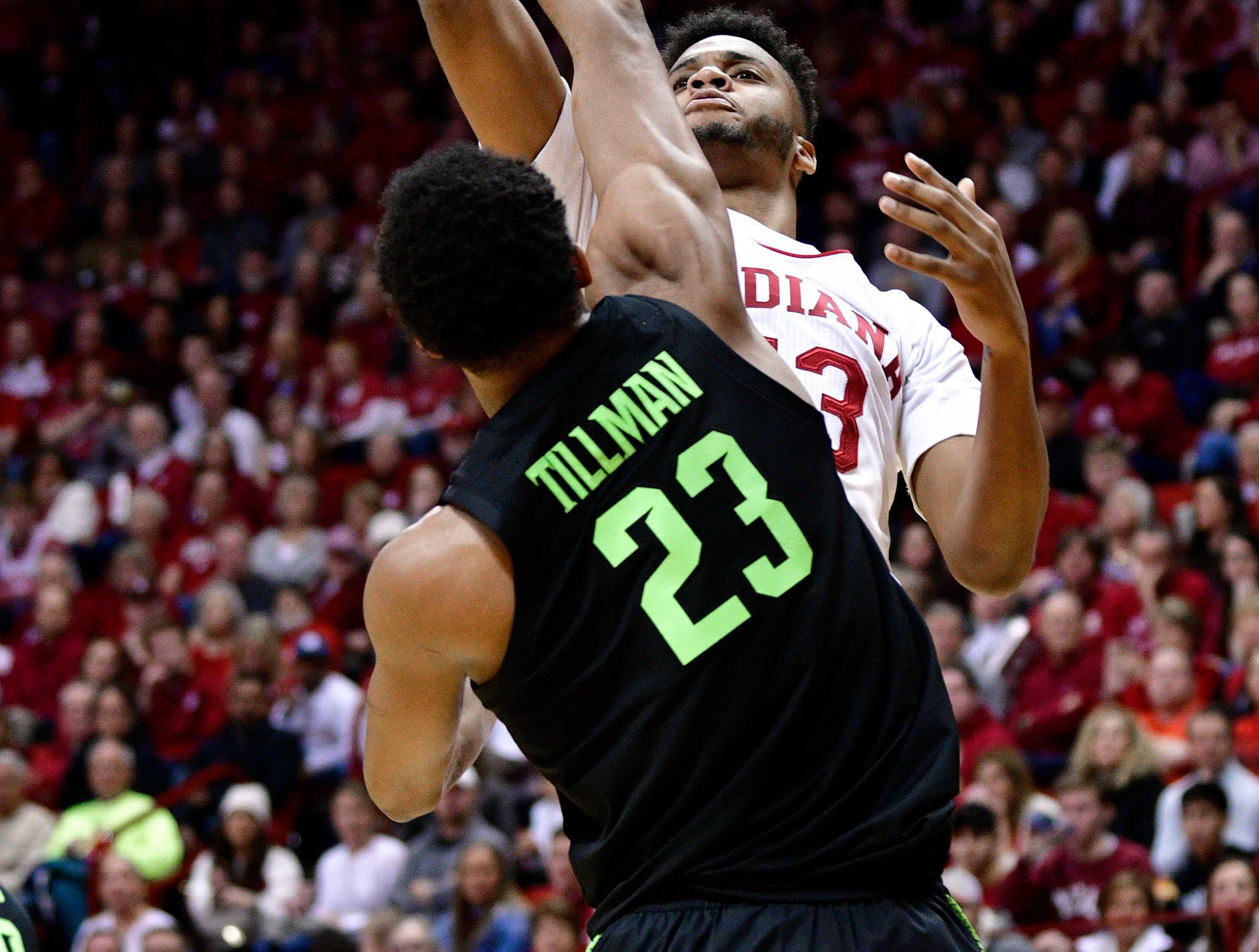 Mar 2, 2019; Bloomington, IN, USA; Indiana Hoosiers forward Juwan Morgan (13) takes a shot over Michigan State Spartans forward Xavier Tillman (23) during the first half of the game at Assembly Hall. Mandatory Credit: Marc Lebryk-USA TODAY Sports