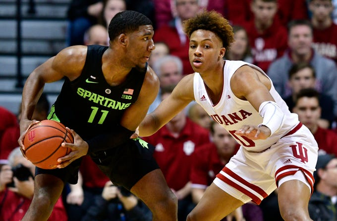Mar 2, 2019; Bloomington, IN, USA;Indiana Hoosiers guard Romeo Langford (0) defends against Michigan State Spartans forward Aaron Henry (11) during the first half of the game at Assembly Hall. Mandatory Credit: Marc Lebryk-USA TODAY Sports