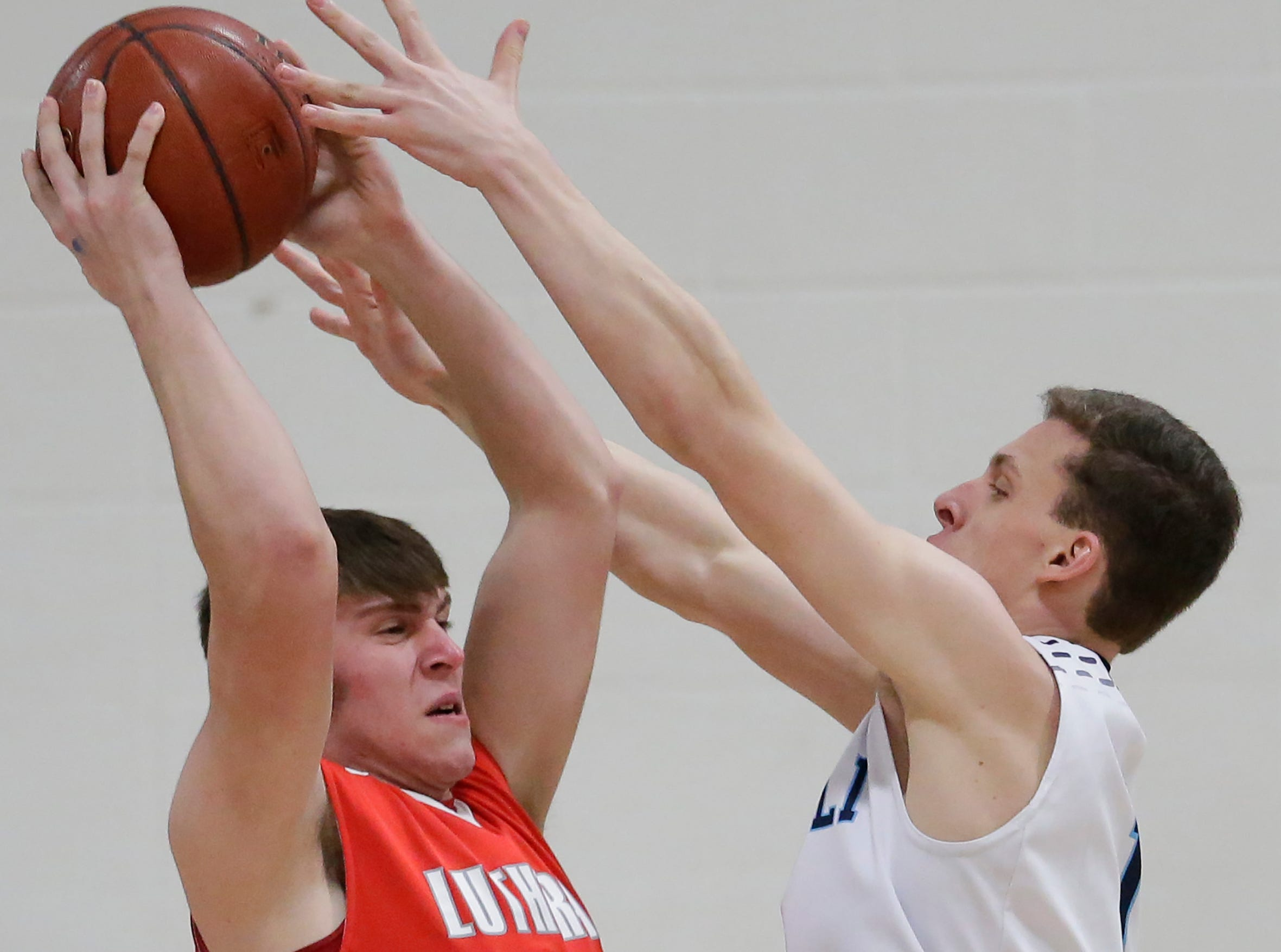 Manitowoc Lutheran's Korey Garceau (40) rebounds against Roncalli during a WIAA Division 4 regional semifinal game at Roncalli High School Friday, March 1, 2019, in Manitowoc, Wis. Joshua Clark/USA TODAY NETWORK-Wisconsin