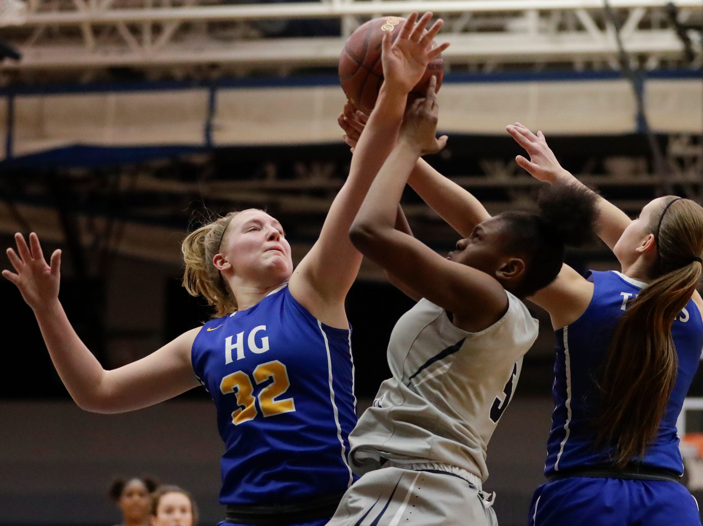 Howards Grove's Madalynn Near (32) battles Milwaukee Academy of Science's Jalisa Batemon (5) for a rebound during a WIAA Division 4 sectional championship game at Sheboygan North High School Saturday, March 2, 2019, in Sheboygan, Wis. Joshua Clark/USA TODAY NETWORK-Wisconsin