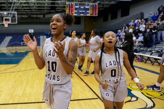 Milwaukee Academy of Science's Shemera Williams (10) and Toniah Williams celebrate the Novas' victory over Howards Grove in a WIAA Division 4 sectional championship game Saturday at Sheboygan North.