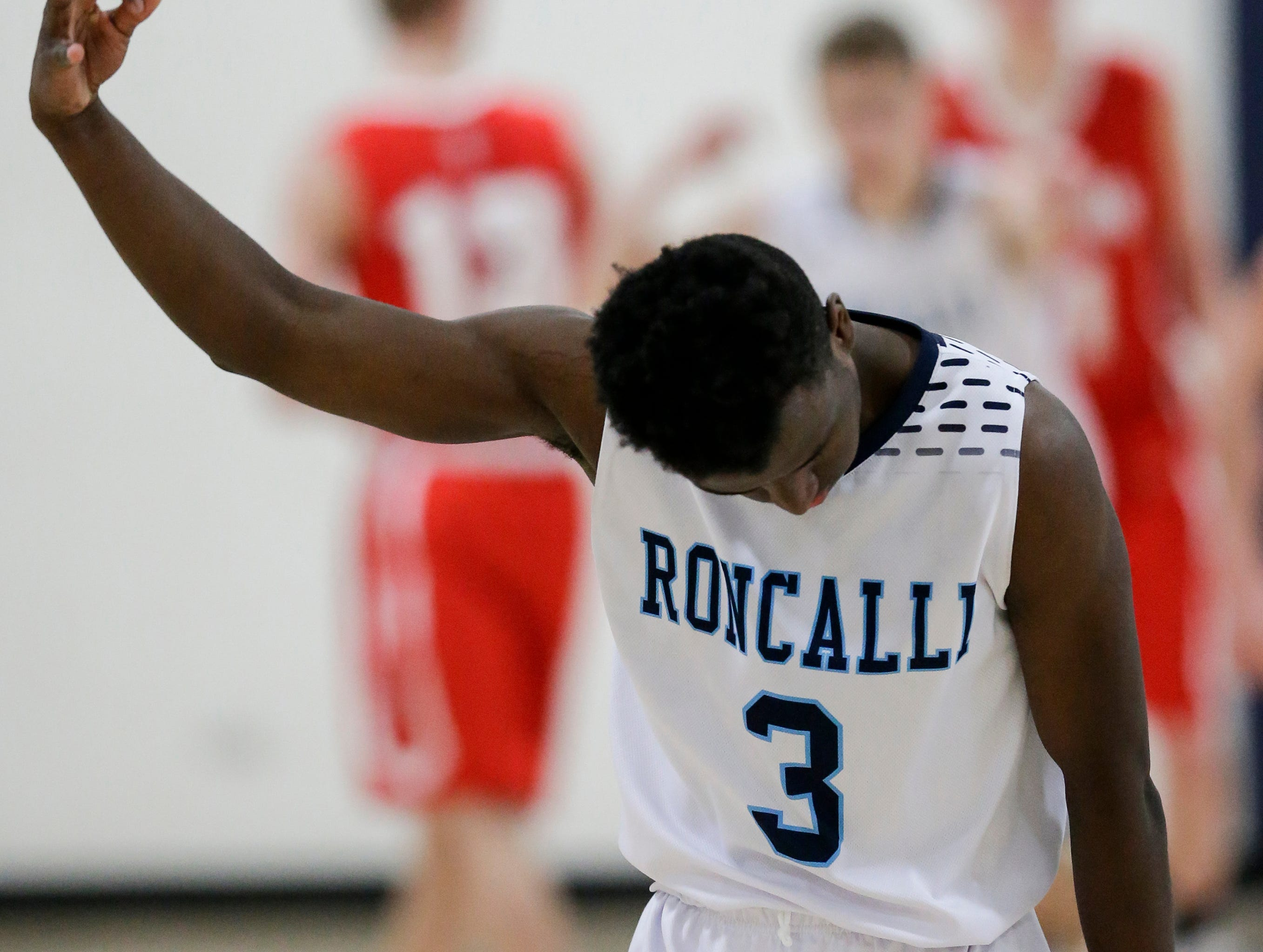 Roncalli's Chombi Lambert reacts after hitting a three point shot to further their lead against Manitowoc Lutheran during a WIAA Division 4 regional semifinal game at Roncalli High School Friday, March 1, 2019, in Manitowoc, Wis. Joshua Clark/USA TODAY NETWORK-Wisconsin