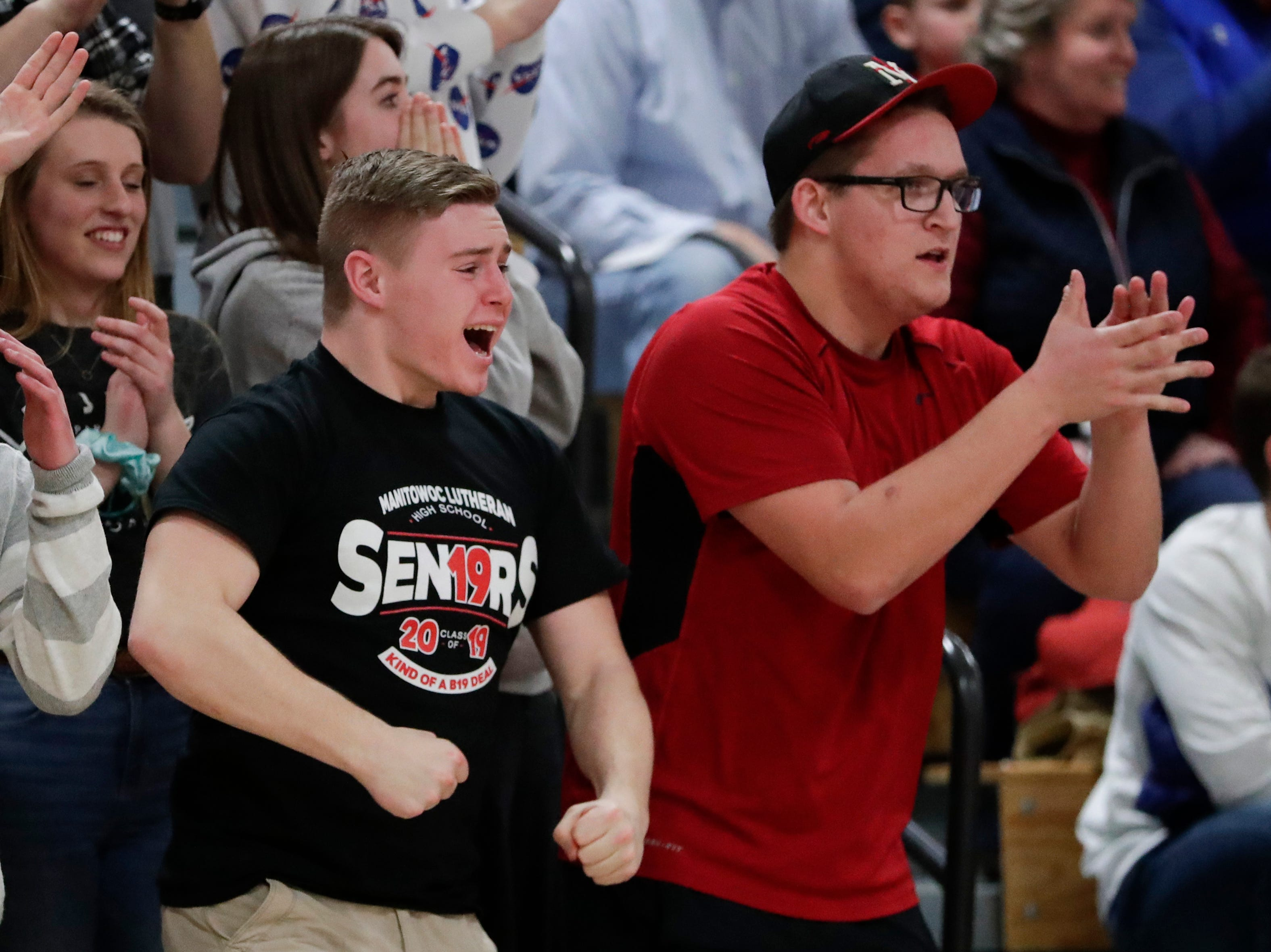 Manitowoc Lutheran's student section cheers as the Lancers lessen the Jets' lead during a WIAA Division 4 regional semifinal game against Roncalli at Roncalli High School Friday, March 1, 2019, in Manitowoc, Wis. Joshua Clark/USA TODAY NETWORK-Wisconsin