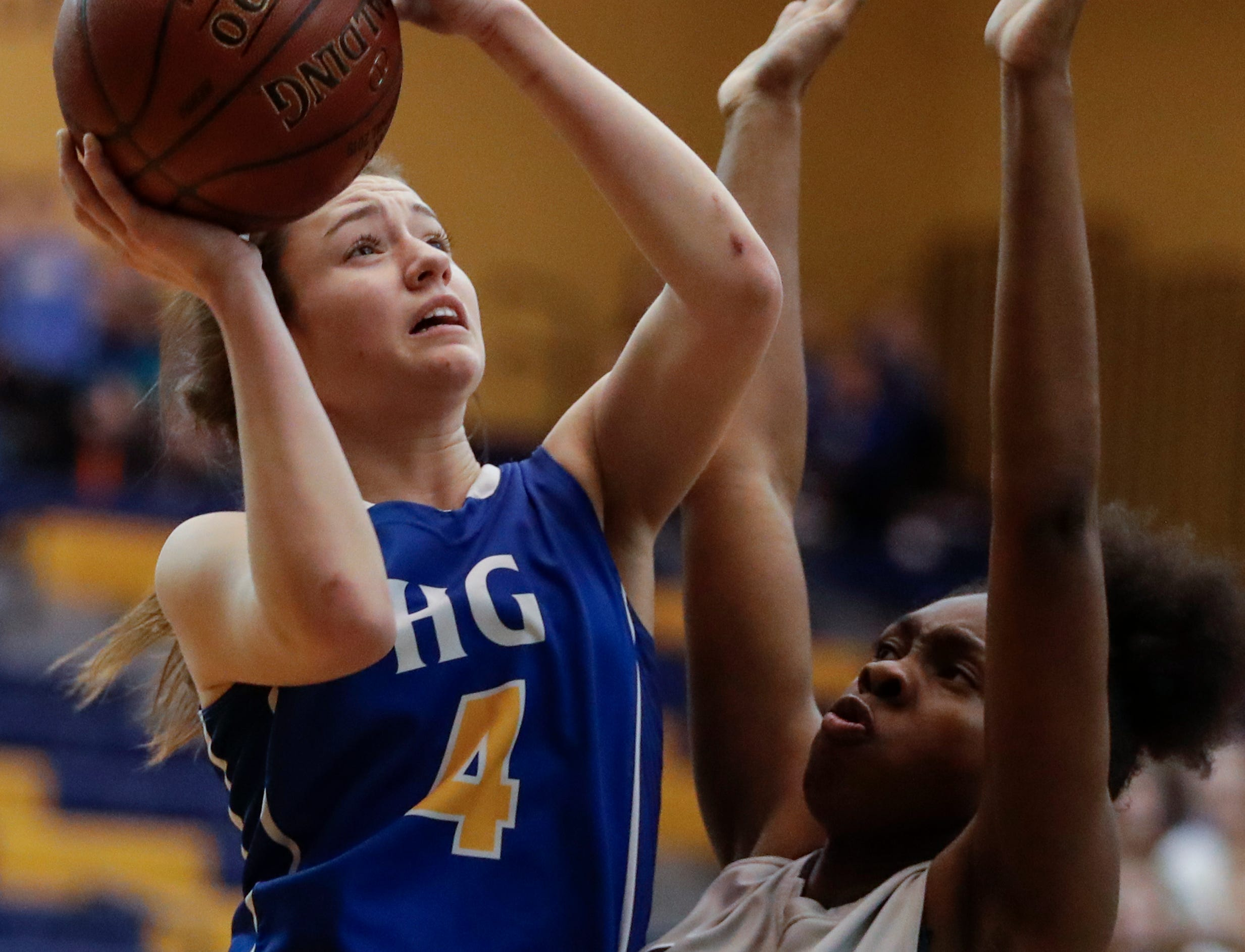 Howards Grove's Mackenzie Holzwart (4) shoots against Milwaukee Academy of Science's Jalisa Batemon (5) during a WIAA Division 4 sectional championship game at Sheboygan North High School Saturday, March 2, 2019, in Sheboygan, Wis. Joshua Clark/USA TODAY NETWORK-Wisconsin