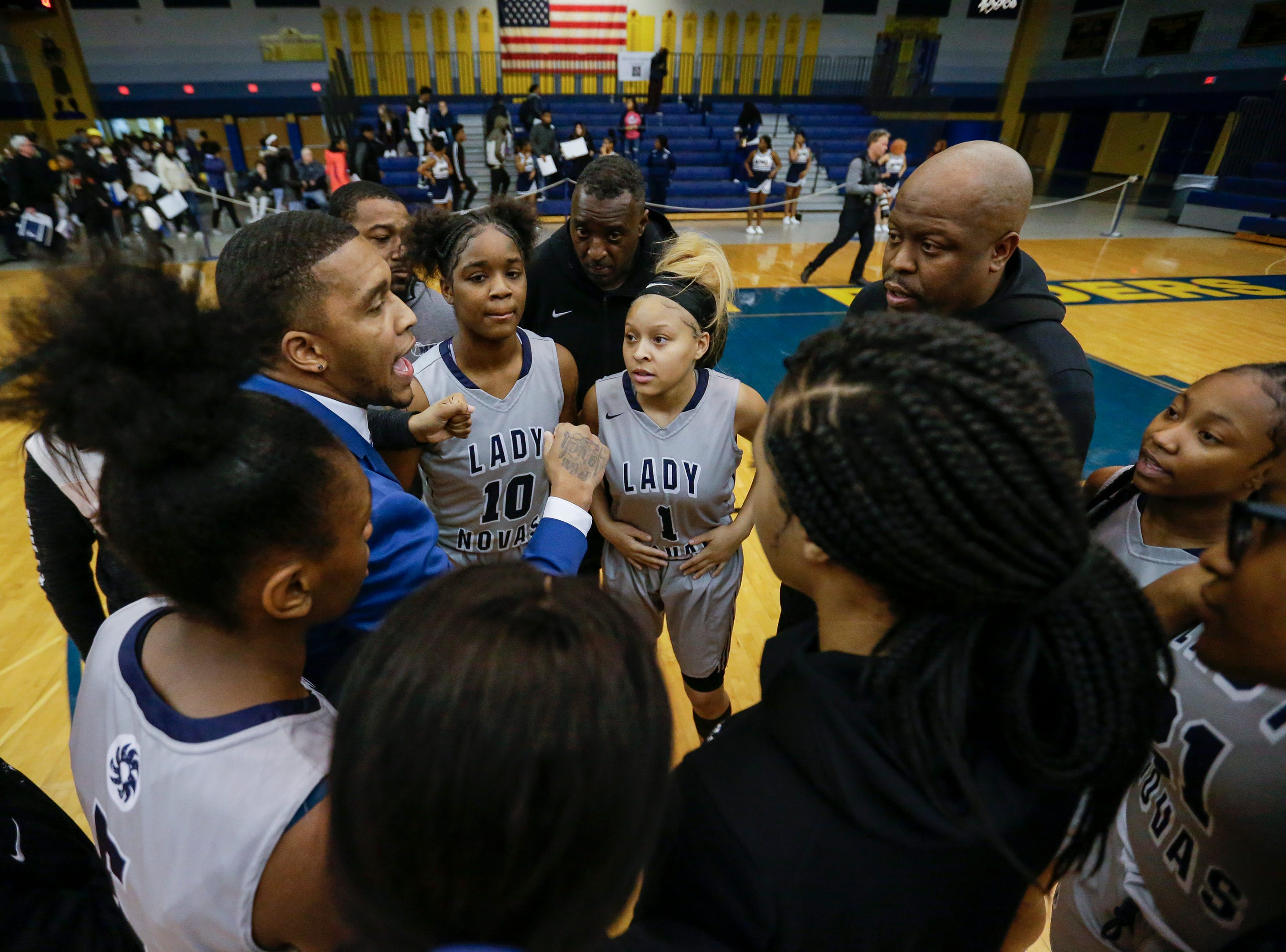 Milwaukee Academy of Science's head coach Giovanni Riley talks to his team before a WIAA Division 4 sectional championship game against Howards Grove High School at Sheboygan North High School Saturday, March 2, 2019, in Sheboygan, Wis. Joshua Clark/USA TODAY NETWORK-Wisconsin