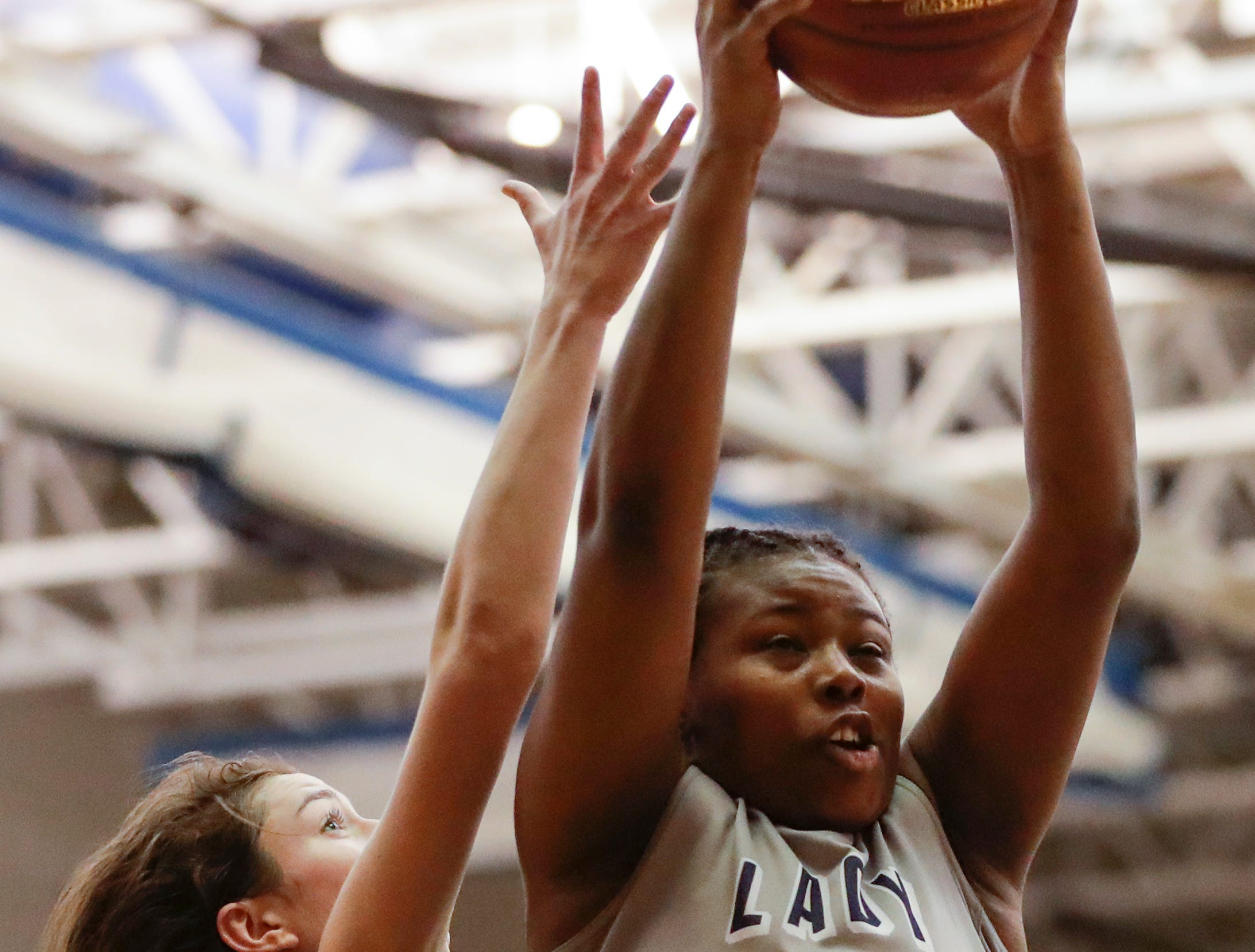 Milwaukee Academy of Science's Nakiyah Hurst (23) rebounds against Howards Grove's Mackenzie Holzwart (4) during a WIAA Division 4 sectional championship game at Sheboygan North High School Saturday, March 2, 2019, in Sheboygan, Wis. Joshua Clark/USA TODAY NETWORK-Wisconsin