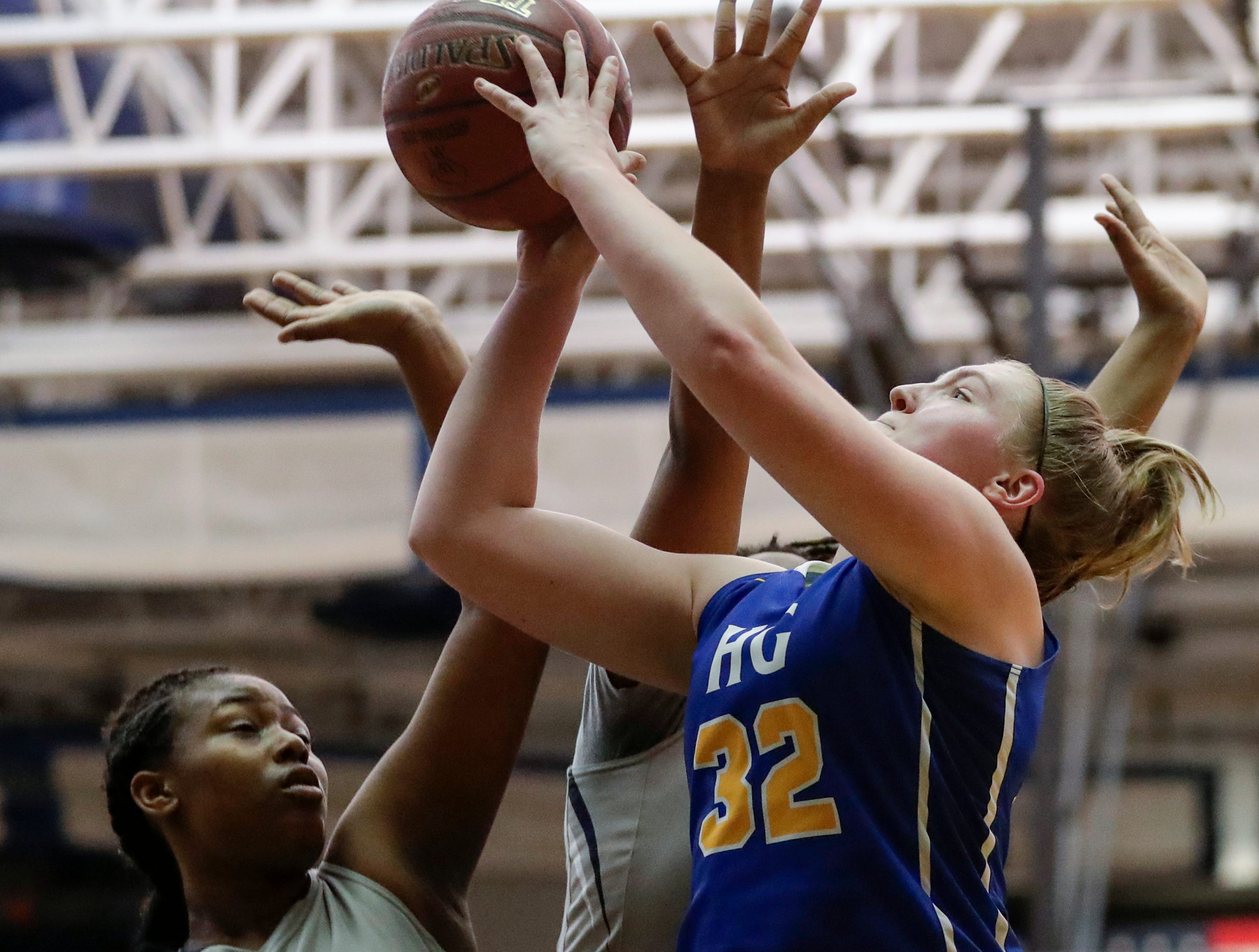 Howards Grove's Madalynn Near shoots against Milwaukee Academy of Science's Nakiyah Hurst during a WIAA Division 4 sectional championship game at Sheboygan North High School Saturday, March 2, 2019, in Sheboygan, Wis. Joshua Clark/USA TODAY NETWORK-Wisconsin