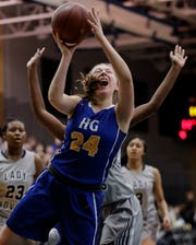 Howards Grove's Kayla Bender (24) shoots against Milwaukee Academy of Science during a WIAA Division 4 sectional championship game Saturday at Sheboygan North High School.