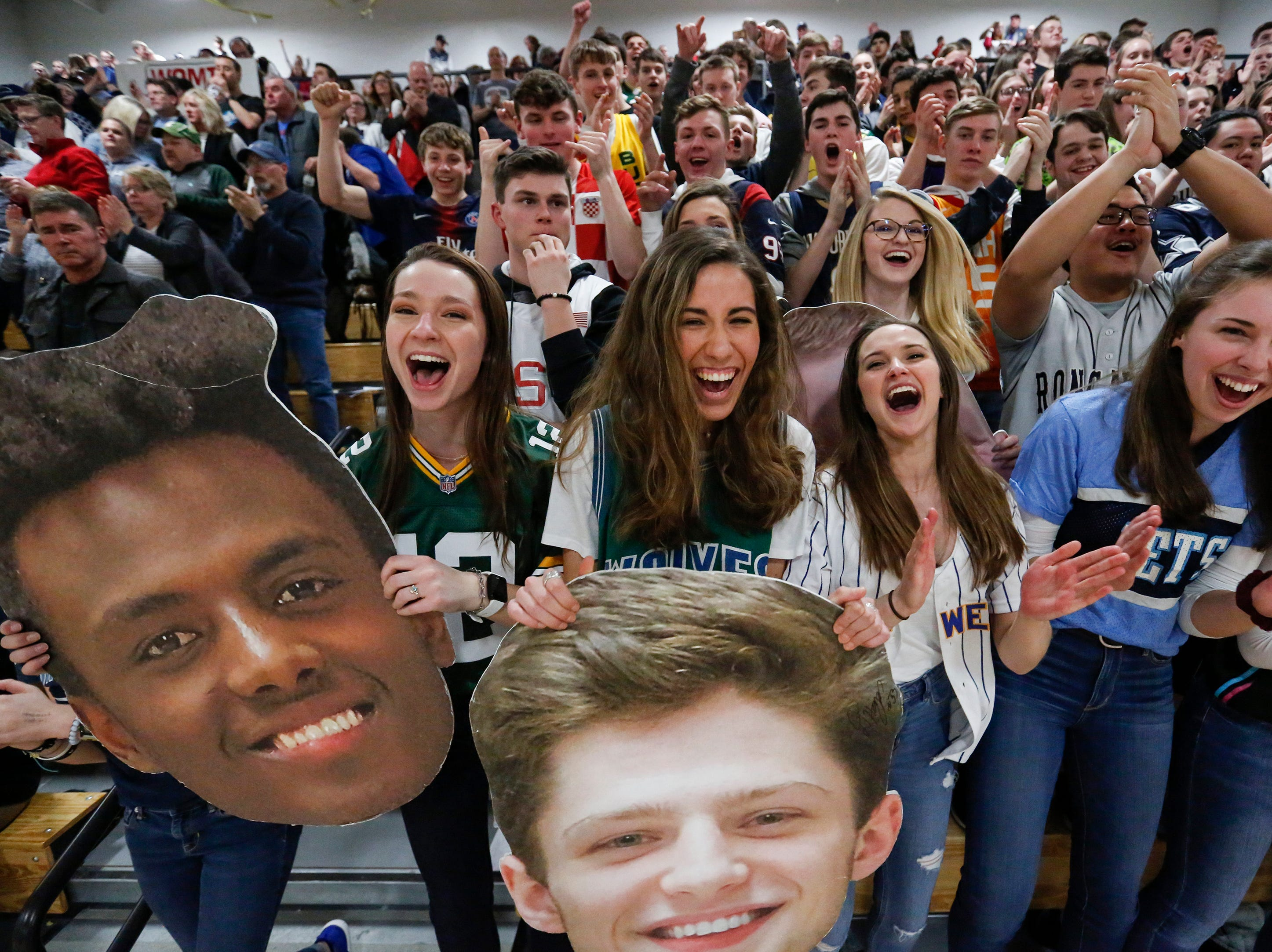 Roncalli's student section cheers after the Jets defeat the Manitowoc Lutheran Lancers 53-44 in a WIAA Division 4 regional semifinal game at Roncalli High School Friday, March 1, 2019, in Manitowoc, Wis. Joshua Clark/USA TODAY NETWORK-Wisconsin