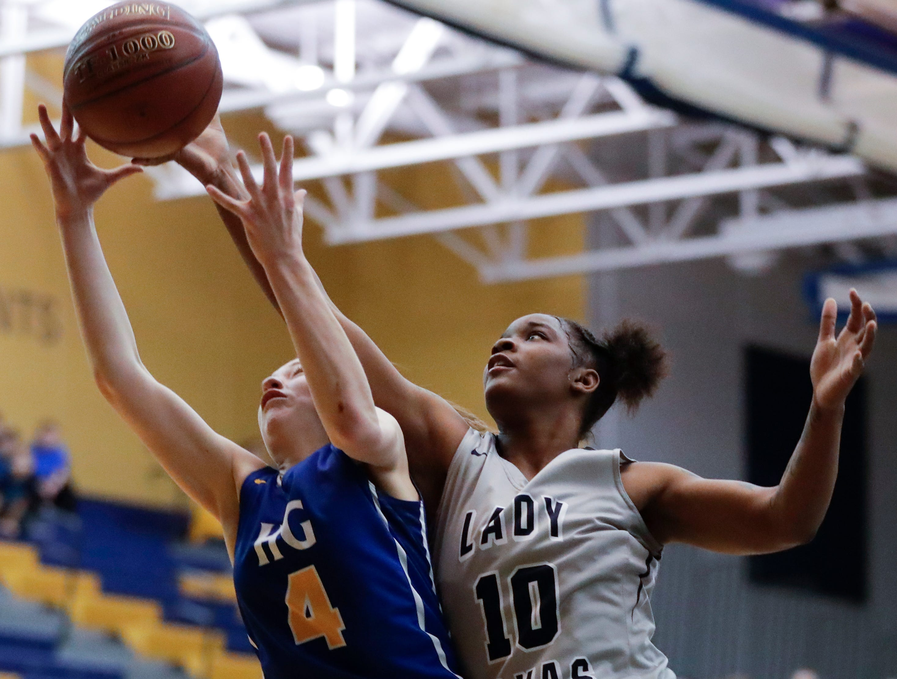Howards Grove's Mackenzie Holzwart (4) battles Milwaukee Academy of Science's Shemera Williams (10) for a rebound during a WIAA Division 4 sectional championship game at Sheboygan North High School Saturday, March 2, 2019, in Sheboygan, Wis. Joshua Clark/USA TODAY NETWORK-Wisconsin