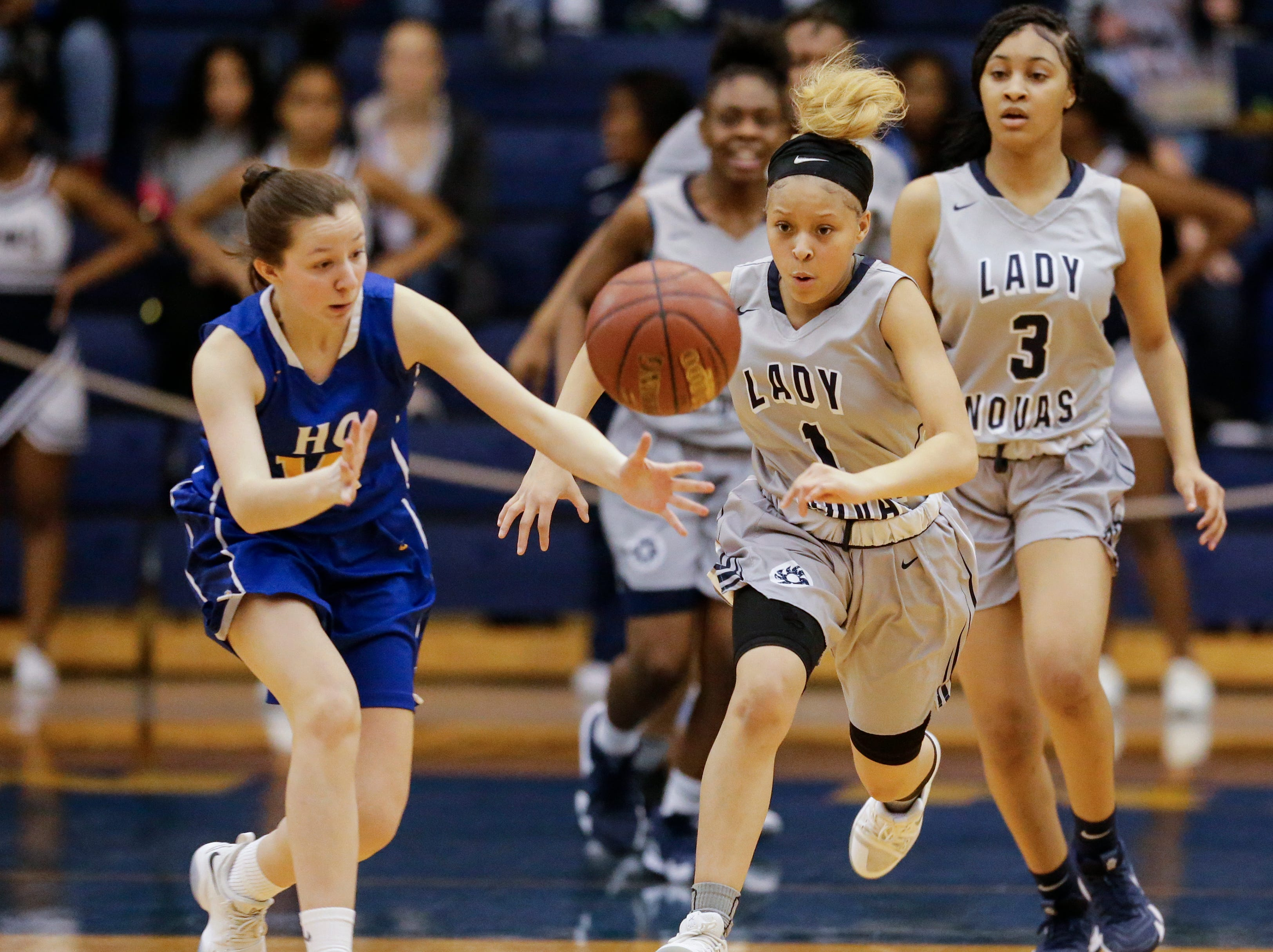 Howards Grove's Riley Jahnke (14) and Milwaukee Academy of Science's DayJanae Bivins (1) race to a loose ball during a WIAA Division 4 sectional championship game at Sheboygan North High School Saturday, March 2, 2019, in Sheboygan, Wis. Joshua Clark/USA TODAY NETWORK-Wisconsin