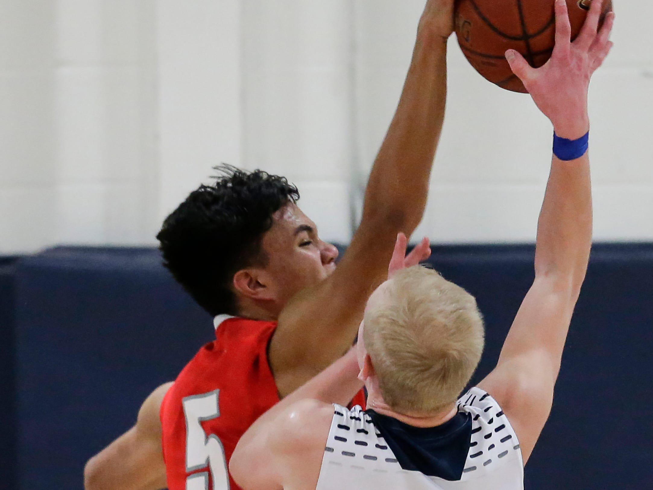 Manitowoc Lutheran's Santana Lomibao (5) blocks a shot from Roncalli's Bryce Pautz (4) during a WIAA Division 4 regional semifinal game at Roncalli High School Friday, March 1, 2019, in Manitowoc, Wis. Joshua Clark/USA TODAY NETWORK-Wisconsin