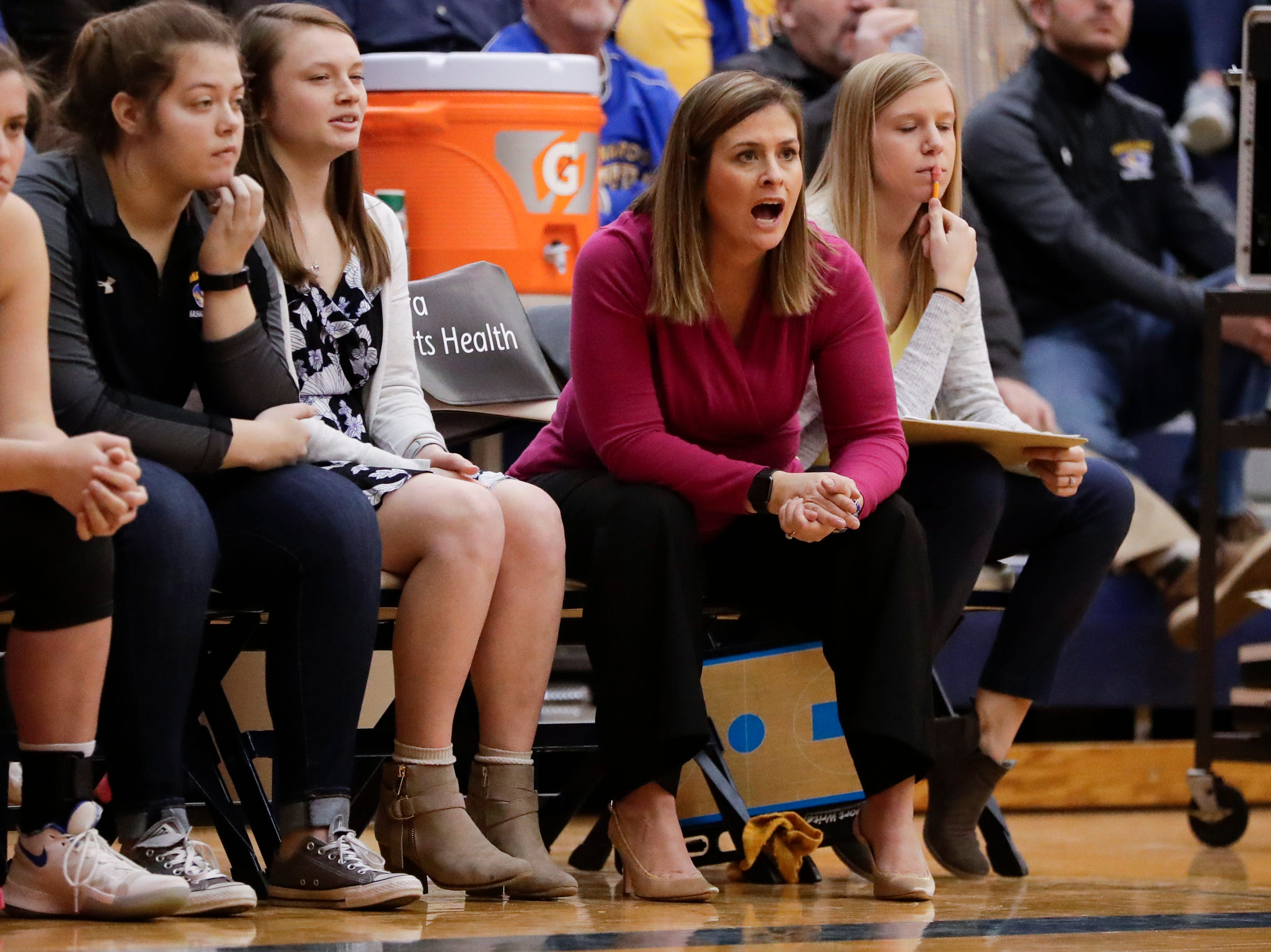 Howards Grove's head coach Heidi Georgeff makes call to her team against Milwaukee Academy of Science during a WIAA Division 4 sectional championship game at Sheboygan North High School Saturday, March 2, 2019, in Sheboygan, Wis. Joshua Clark/USA TODAY NETWORK-Wisconsin