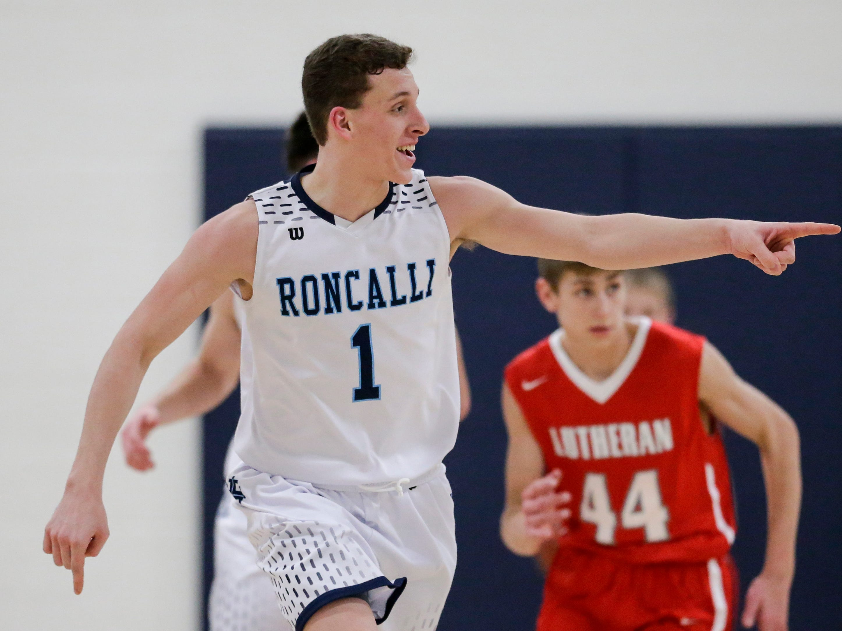 Roncalli's Daniel Burgarino (1) points to his teammate after he scores against Manitowoc Lutheran during a WIAA Division 4 regional semifinal game at Roncalli High School Friday, March 1, 2019, in Manitowoc, Wis. Joshua Clark/USA TODAY NETWORK-Wisconsin