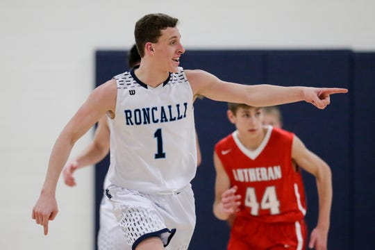 Manitowoc Roncalli's Daniel Burgarino (1) points to his teammate after scoring against Manitowoc Lutheran during a WIAA Division 4 regional semifinal game Friday at Roncalli High School in Manitowoc.