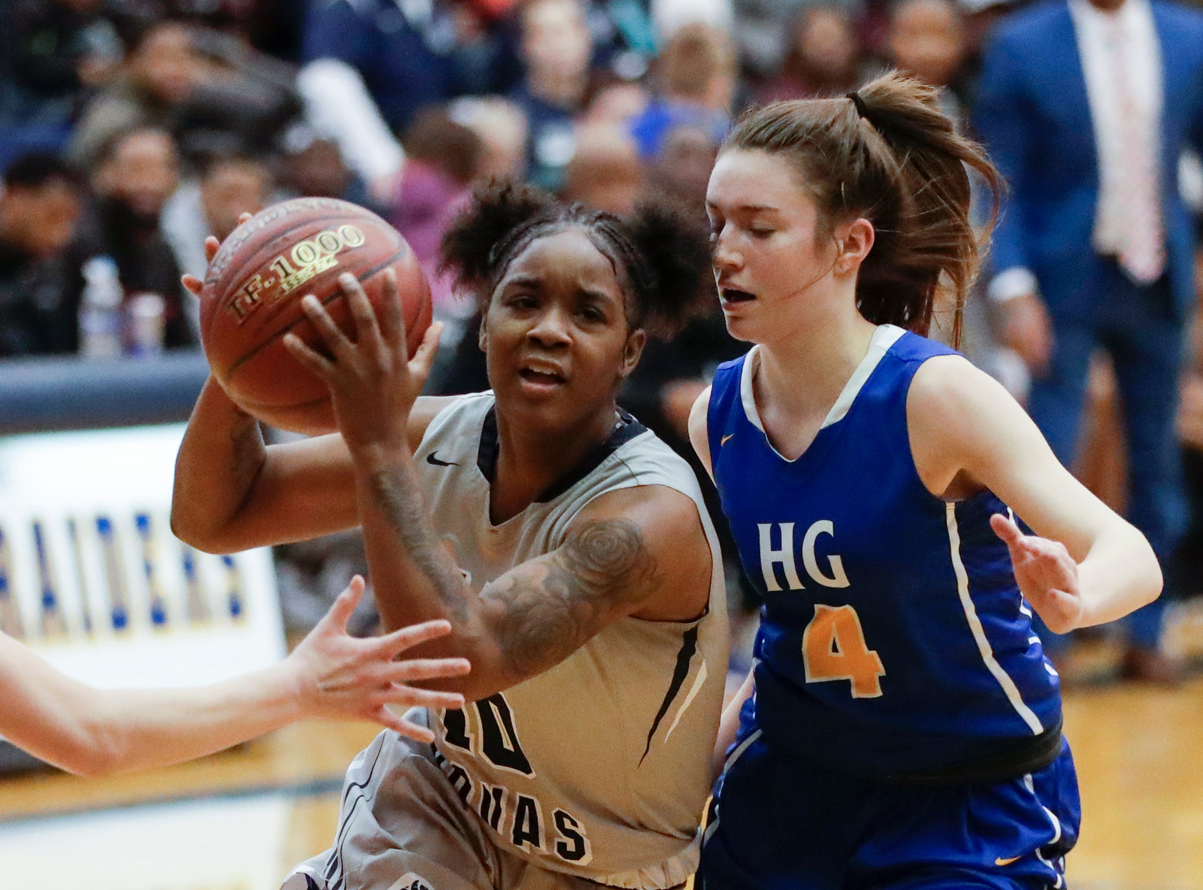 Milwaukee Academy of Science's Shemera Williams (10) drives to the basket against Howards Grove's Mackenzie Holzwart (4) during a WIAA Division 4 sectional championship game at Sheboygan North High School Saturday, March 2, 2019, in Sheboygan, Wis. Joshua Clark/USA TODAY NETWORK-Wisconsin