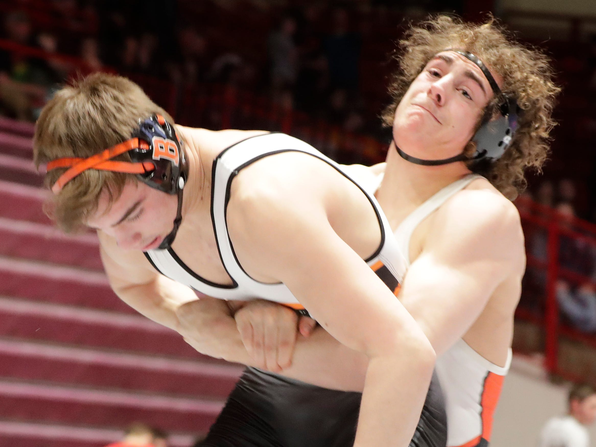 Bentley Schwanebeck-Ostermann, right, wrestles Burlington's Zach Wallace in a 182-pound match, Friday, March 1, 2019, in Madison, Wis.