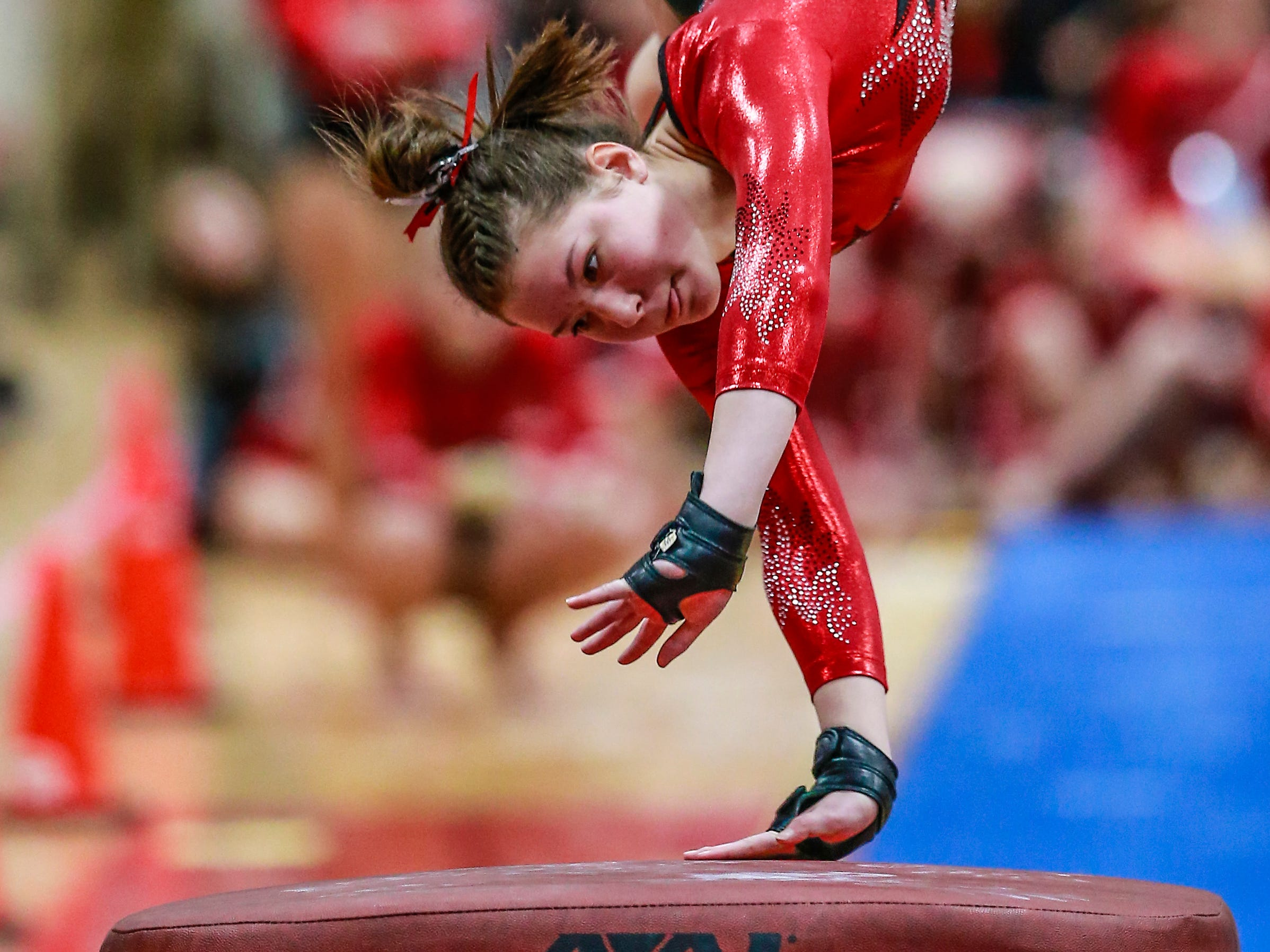 Medford's Megan Wanke competes in the vaulting during WIAA state gymnastics competition Friday, March 1, 2019, at Lincoln High School Field House in Wisconsin Rapids, Wis. T'xer Zhon Kha/USA TODAY NETWORK-Wisconsin
