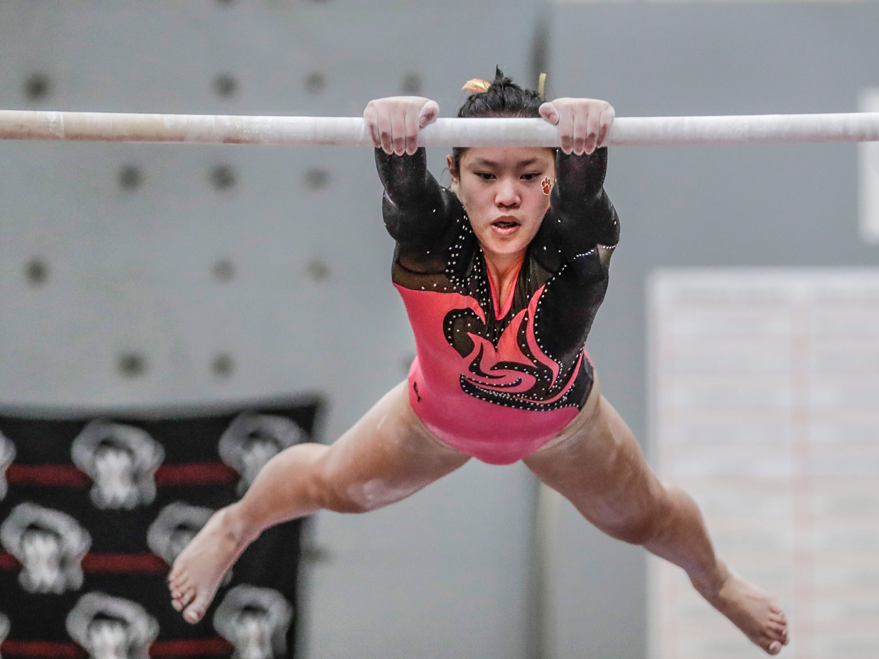 Marshfield's Hanna Merkel competes in the uneven parallel bars during WIAA state gymnastics competition Friday, March 1, 2019, at Lincoln High School Field House in Wisconsin Rapids, Wis. T'xer Zhon Kha/USA TODAY NETWORK-Wisconsin