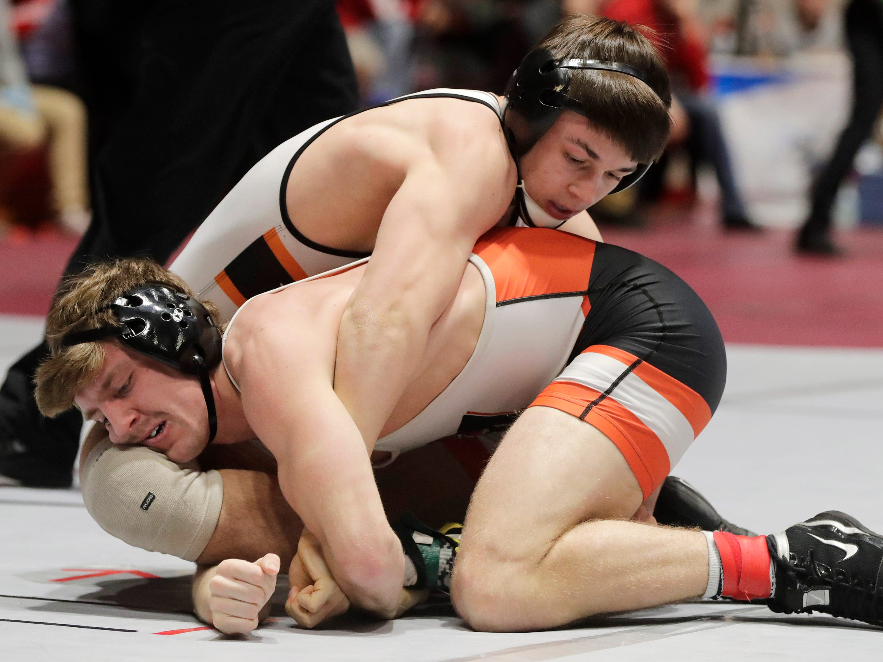 Marshfield's Caden Pearce, left, wrestles Burlington's Cody Welker in a 145-pound match, Friday, March 1, 2019, in Madison, Wis.