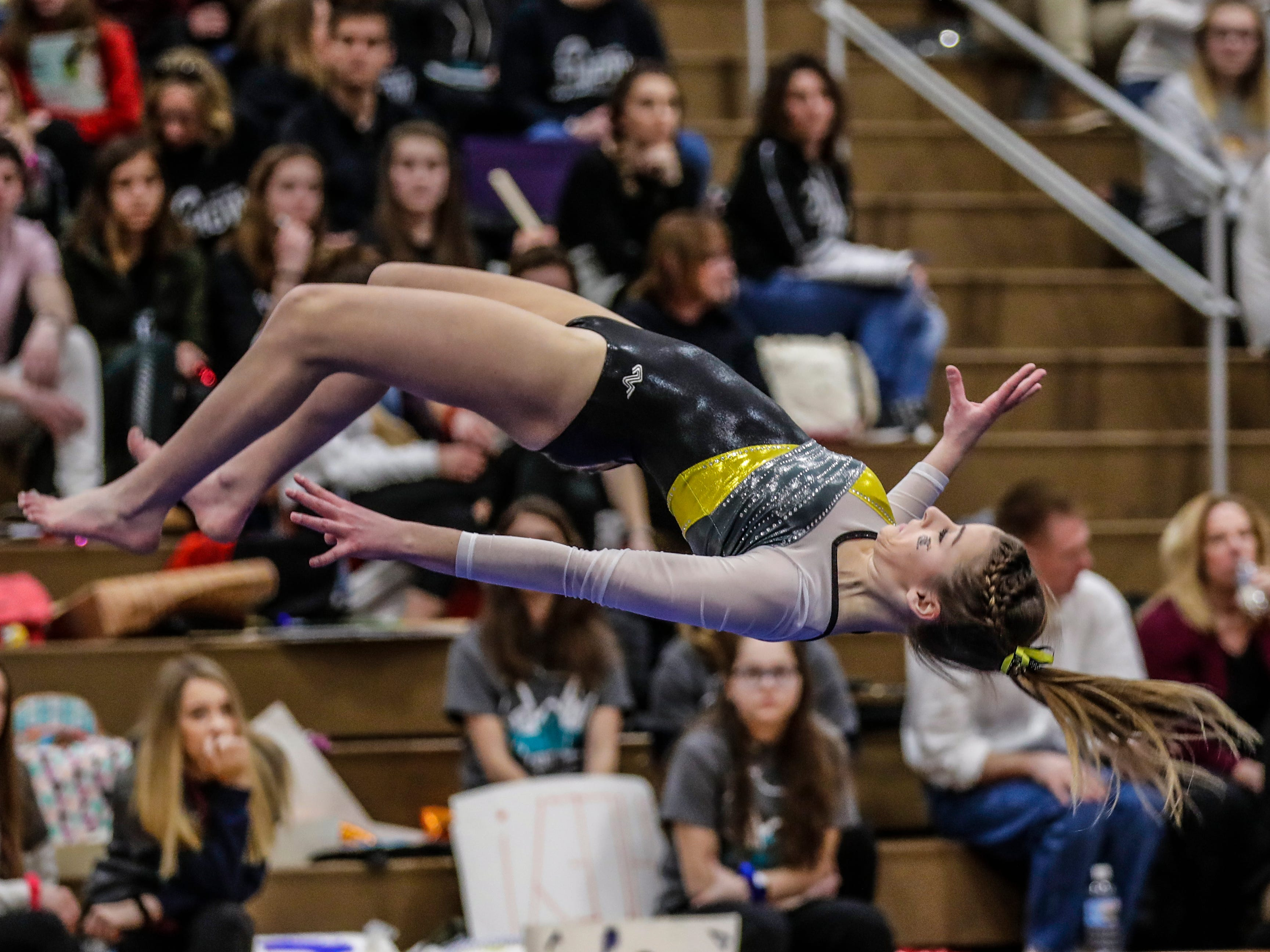 Waupun's Eryn Hautamaki competes in the floor exercise during WIAA state gymnastics competition Friday, March 1, 2019, at Lincoln High School Field House in Wisconsin Rapids, Wis. T'xer Zhon Kha/USA TODAY NETWORK-Wisconsin
