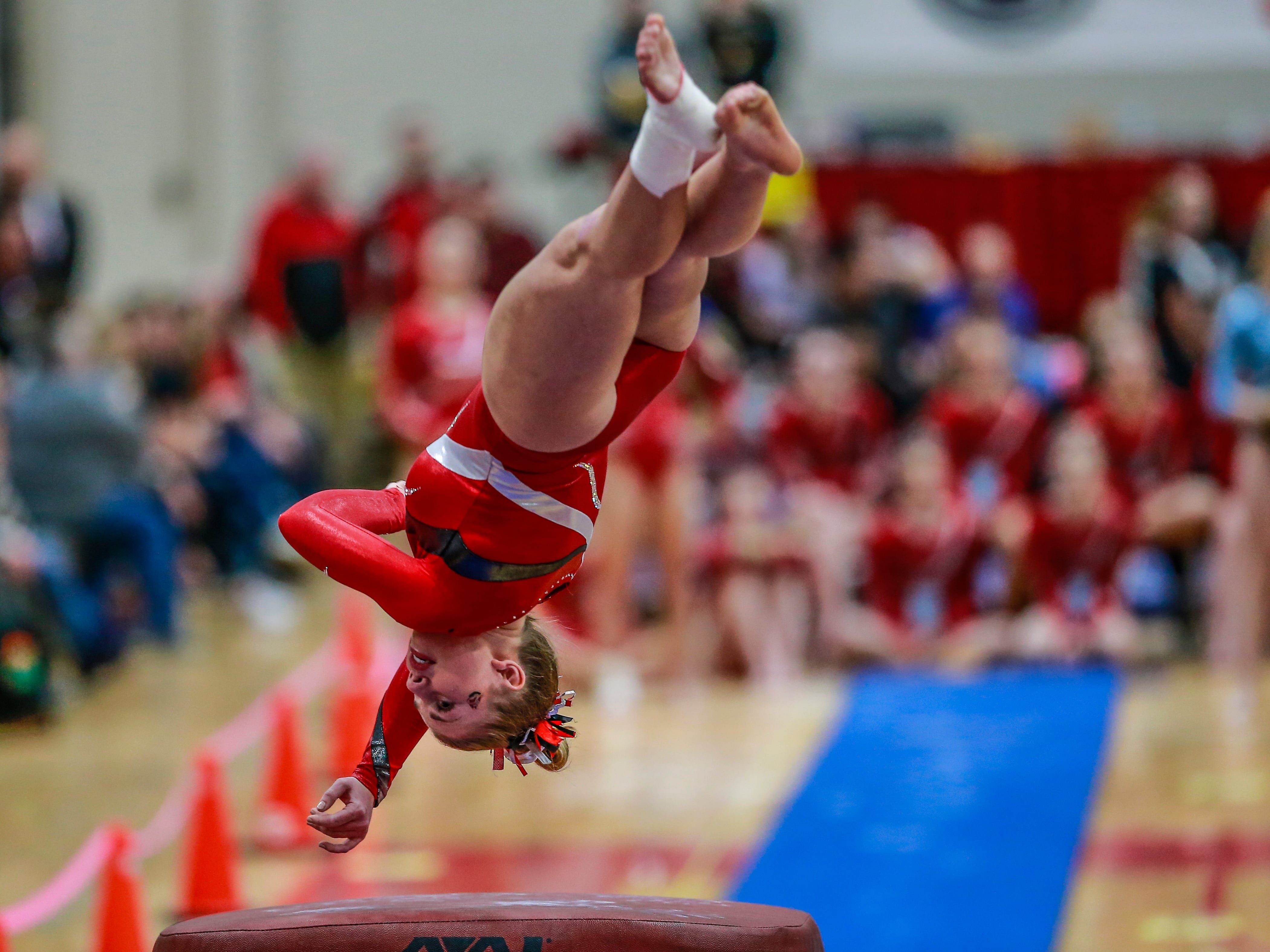 Manitowoc Lincoln's Breana Reinhart competes in the vaulting during WIAA state gymnastics competition Friday, March 1, 2019, at Lincoln High School Field House in Wisconsin Rapids, Wis. T'xer Zhon Kha/USA TODAY NETWORK-Wisconsin