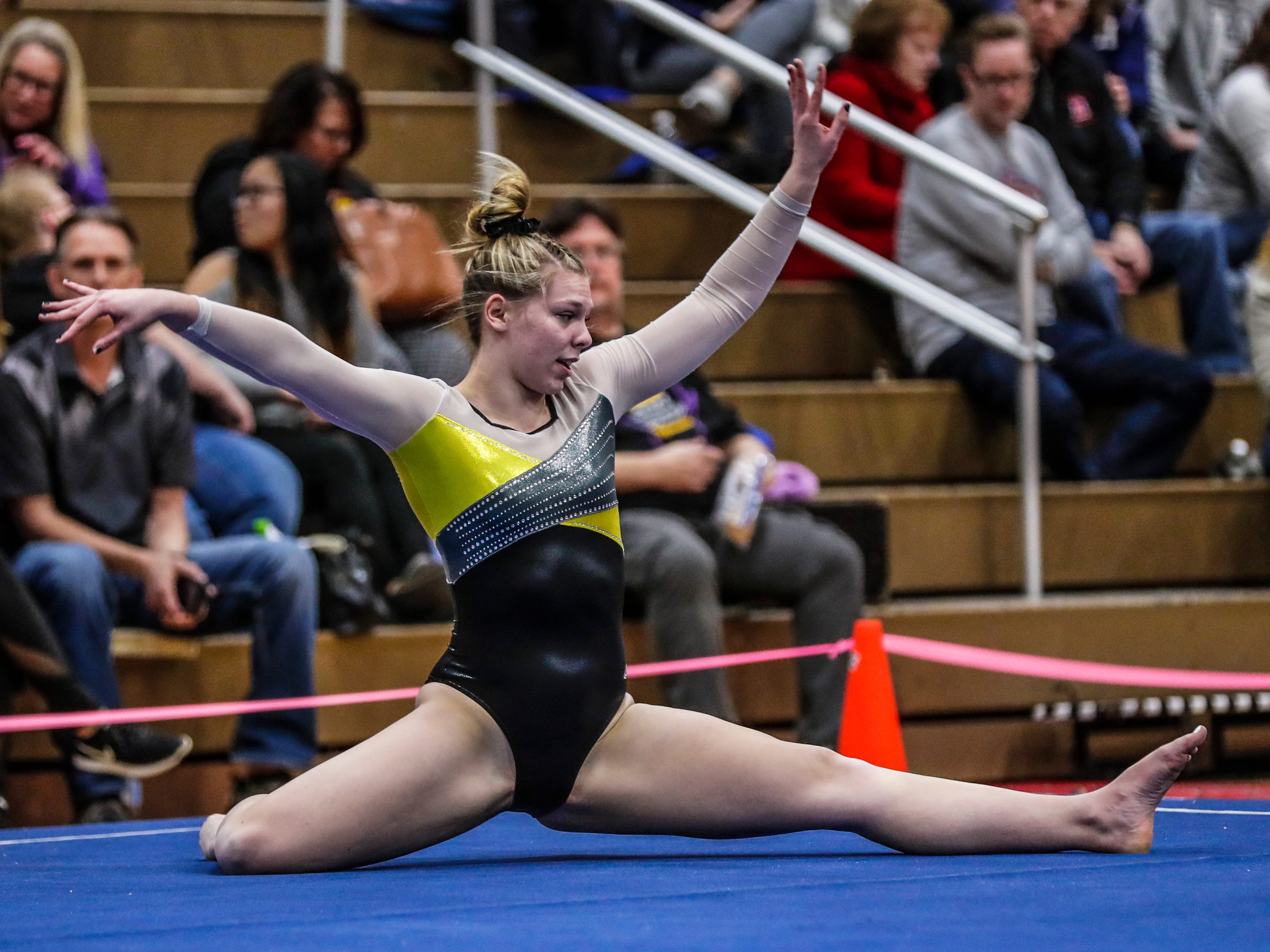 Waupun's Emily Rens competes in the floor exercise during WIAA state gymnastics competition Friday, March 1, 2019, at Lincoln High School Field House in Wisconsin Rapids, Wis. T'xer Zhon Kha/USA TODAY NETWORK-Wisconsin