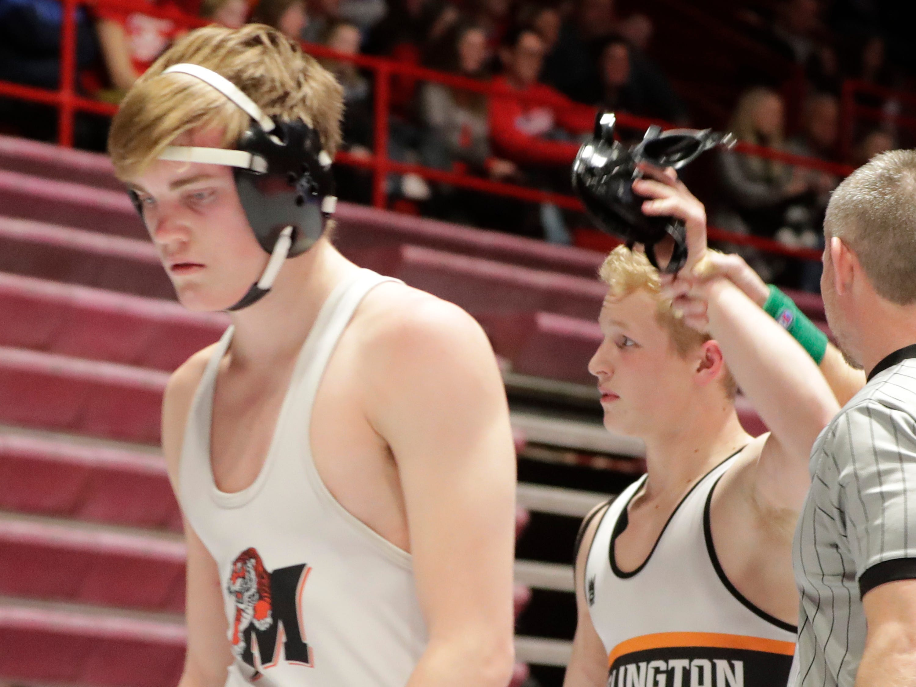 Burlington's Jake Skrundz, right, arm is raised in victory over Marshfield's Brenden Braund, in a 160-pound match, Friday, March 1, 2019, in Madison, Wis.