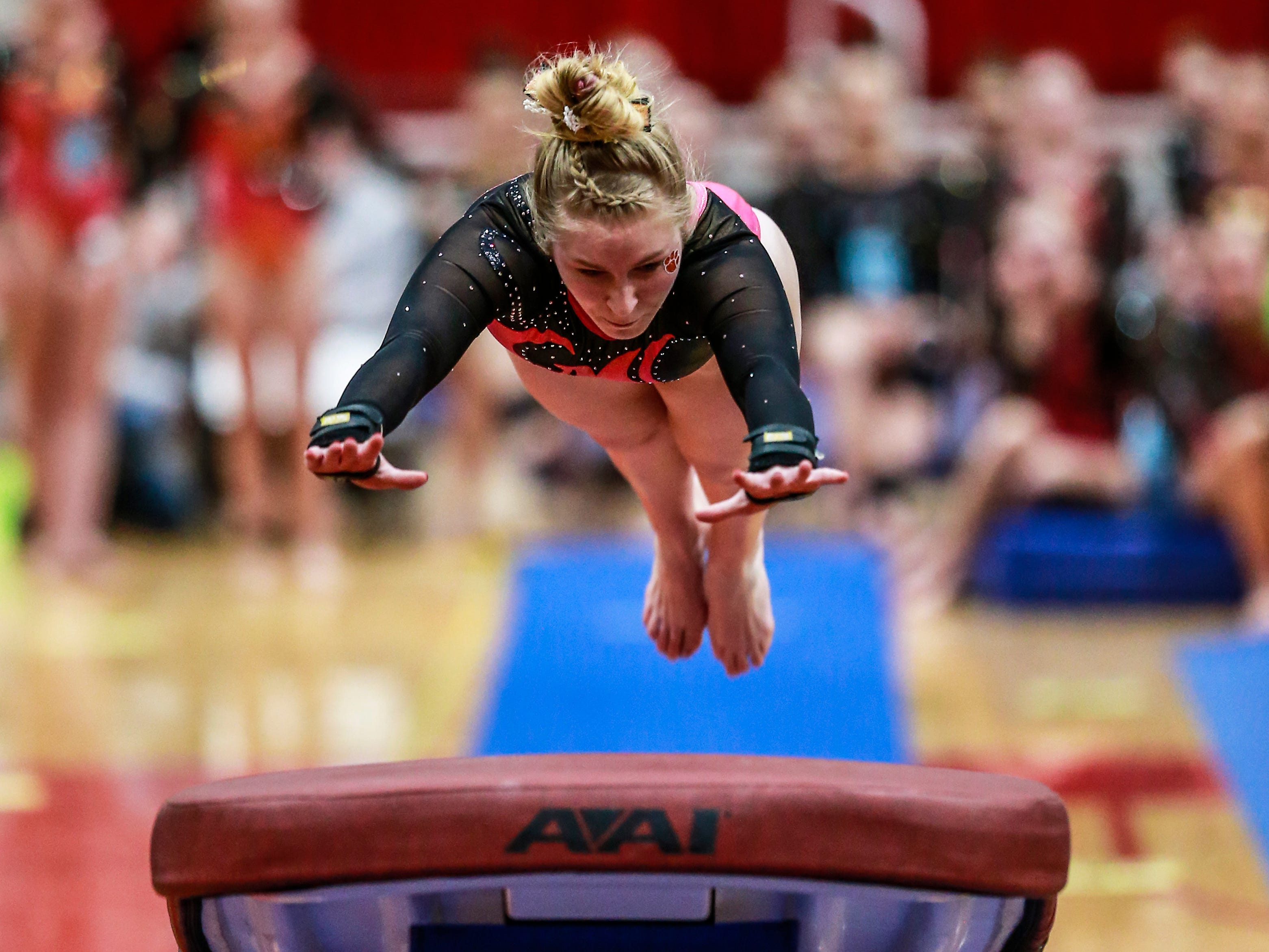 Marshfield's Emma Haugen competes in the vaulting during WIAA state gymnastics competition Friday, March 1, 2019, at Lincoln High School Field House in Wisconsin Rapids, Wis. T'xer Zhon Kha/USA TODAY NETWORK-Wisconsin