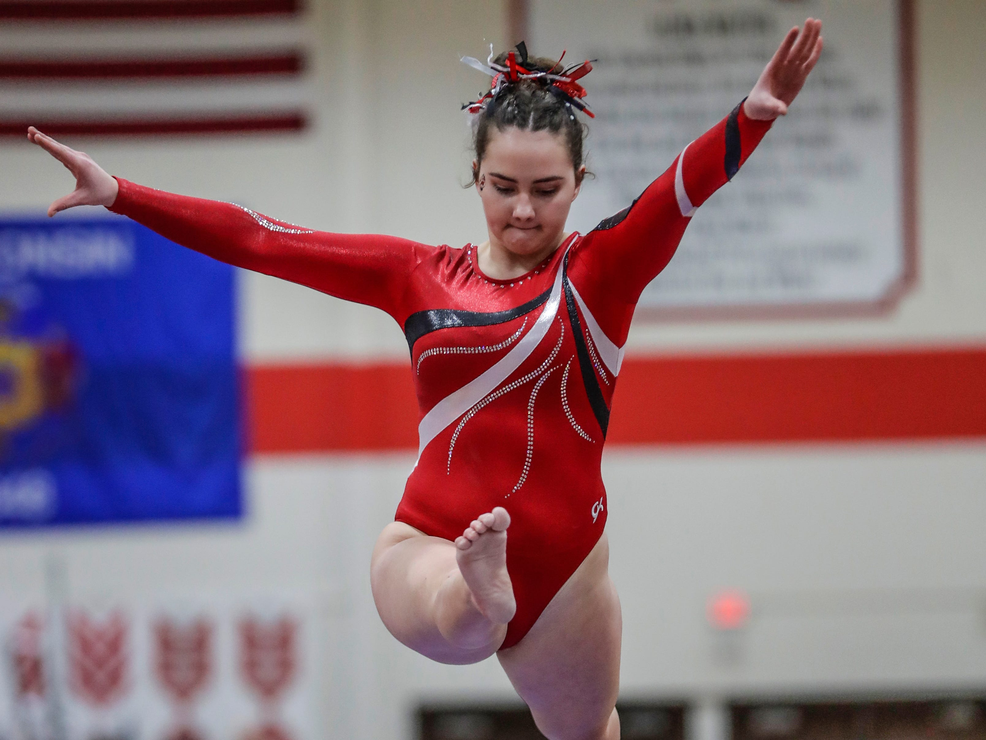 Manitowoc Lincoln's Courtney Youngchild competes on the balance beam in Division 1 during WIAA state gymnastics competition Friday, March 1, 2019, at Lincoln High School Field House in Wisconsin Rapids, Wis. T'xer Zhon Kha/USA TODAY NETWORK-Wisconsin