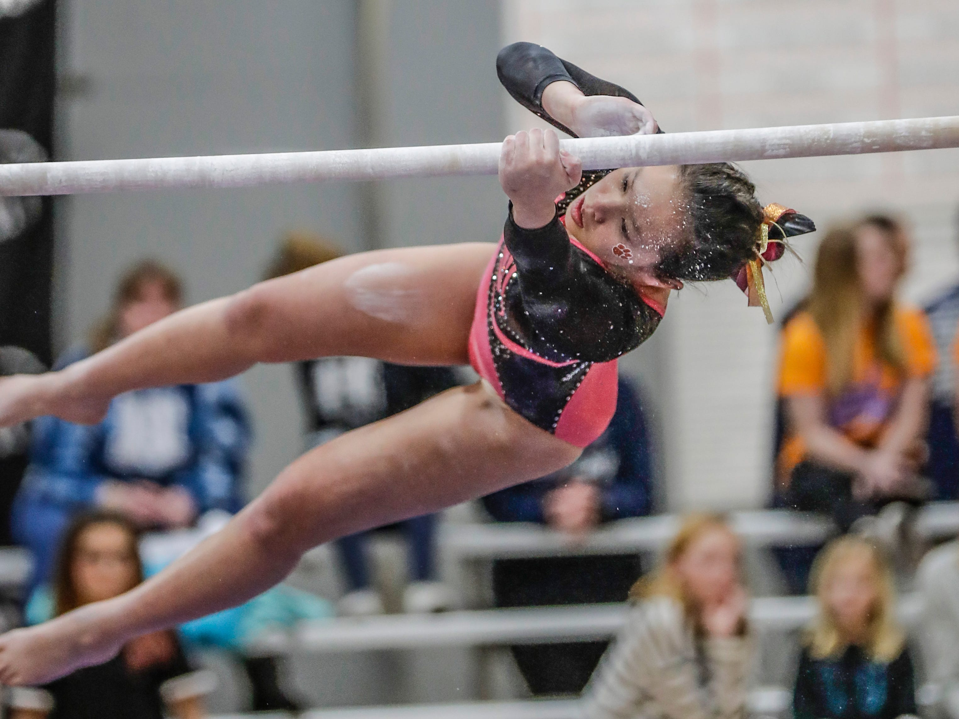 Marshfield's Hanna Merkel switches her hands on the uneven parallel bars during WIAA state gymnastics competition Friday, March 1, 2019, at Lincoln High School Field House in Wisconsin Rapids, Wis. T'xer Zhon Kha/USA TODAY NETWORK-Wisconsin