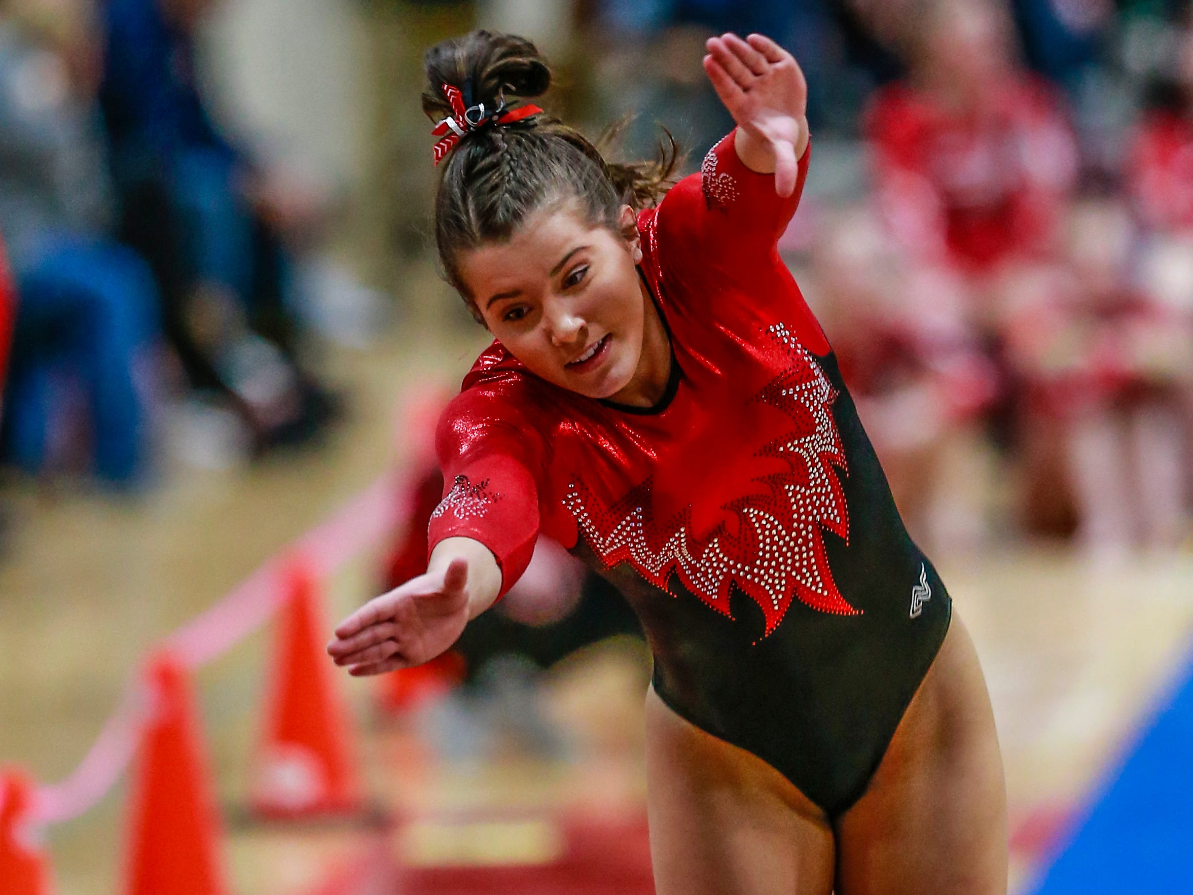 Medford's Maddy Wanke competes in the vaulting during WIAA state gymnastics competition Friday, March 1, 2019, at Lincoln High School Field House in Wisconsin Rapids, Wis. T'xer Zhon Kha/USA TODAY NETWORK-Wisconsin