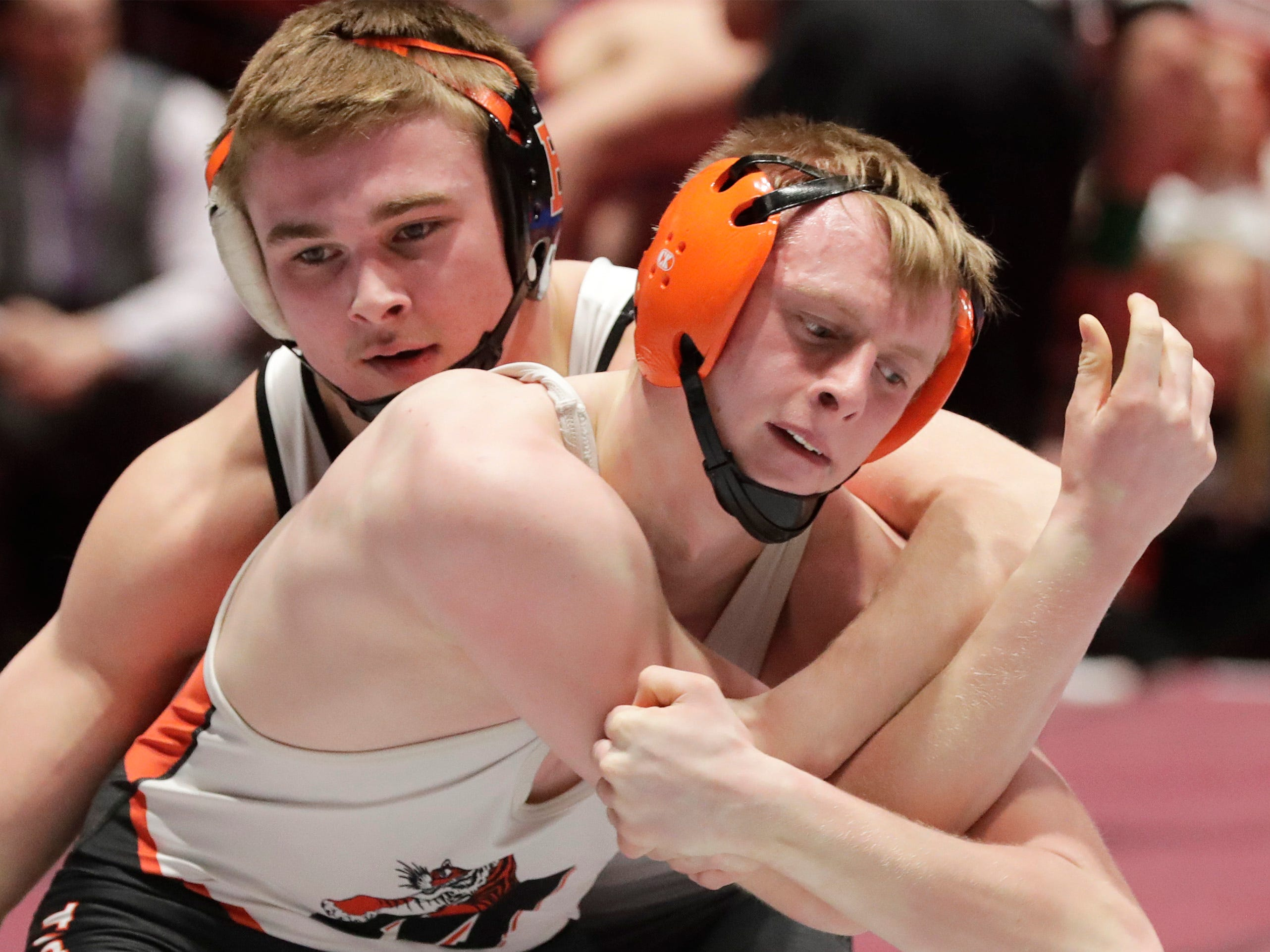 Burlington's Qwade Gehring, left, wrestles Marshfield's Bradley Hendrickson in a 170-pound match, Friday, March 1, 2019, in Madison, Wis.