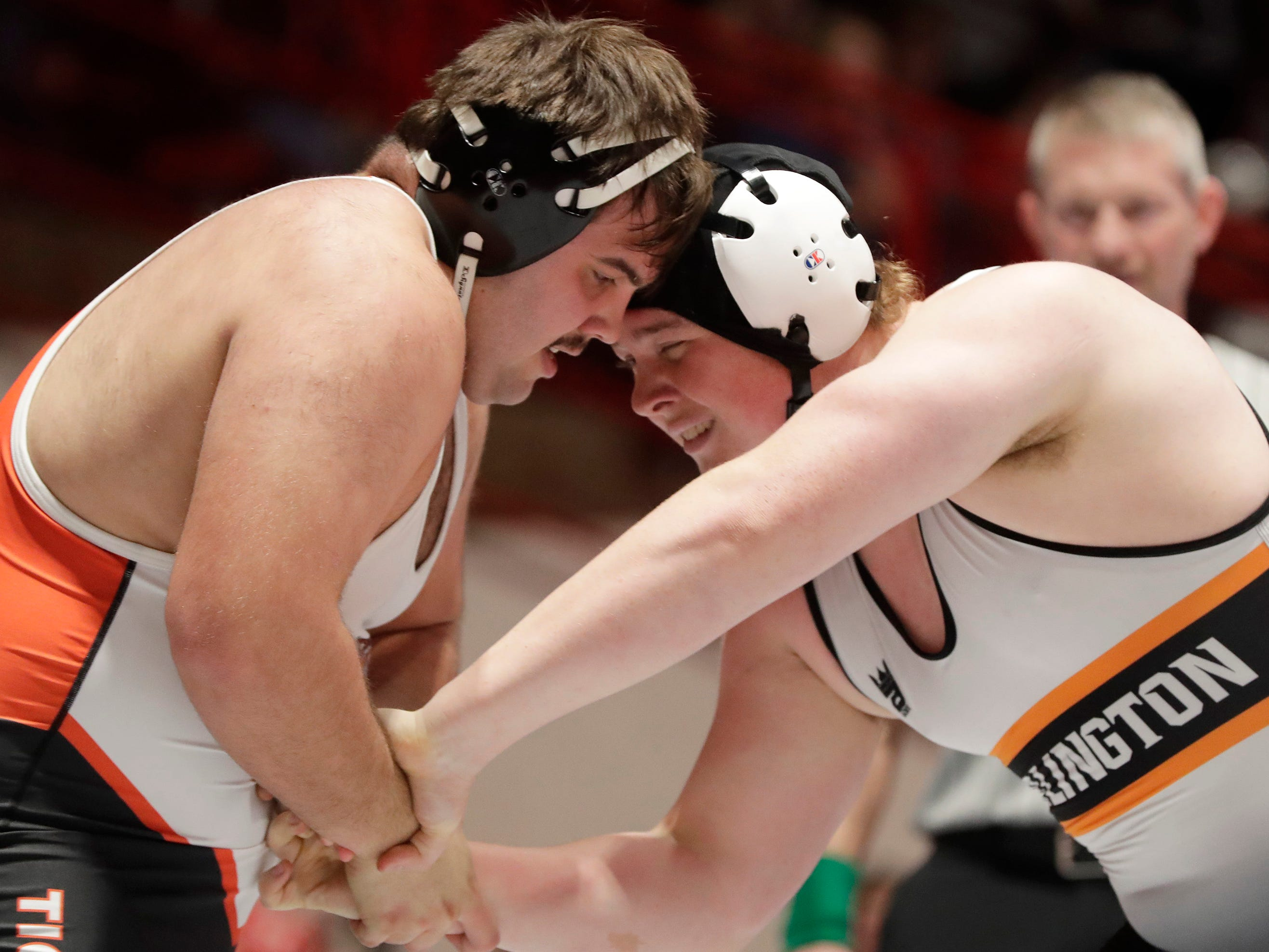 Marshfield's Samual Haessly, left, wrestles Burlington's Wyatt Hayes in a 285-pound match during a WIAA state wrestling team tournament quarterfinal at the UW Field House.