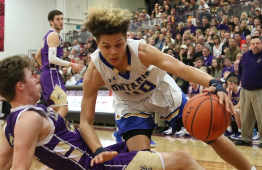 Ontario's Jayden Jacobs drives to the basket during the Warriors' 45-41 win over Lexington in the Division II sectional final on Friday night at Willard High School.