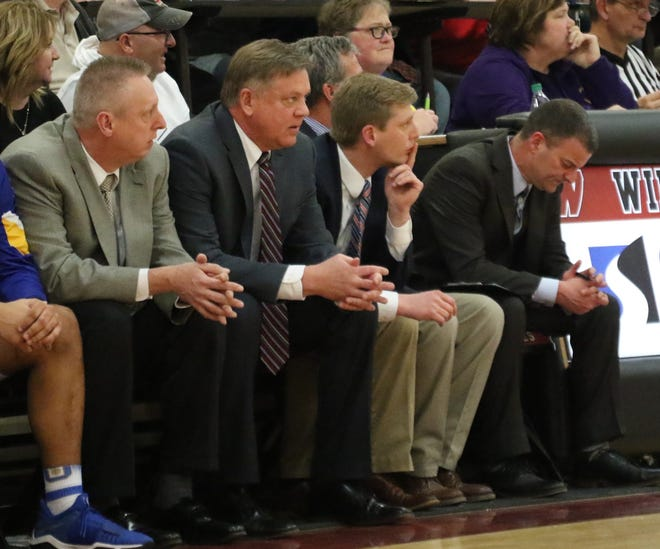 Ontario's head coach Joe Balogh, surrounded by assistants, watches as the Ontario Warriors upset the Lexington Minutemen in the Division II sectional tournament.