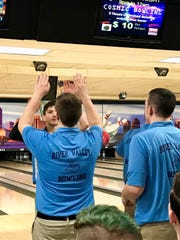 River Valley's Nick Manning gets high fives from teammates at the 2019 Division II boys state bowling tournament.