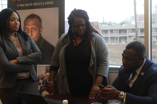 Bryanta Booker-Maxwell (left), and chairpersons Lea Webb (middle) and Wes Bellamy (right) talk during the Inaugural 2019 Black Millennial Political Convention at the National Civil Rights Museum on Saturday.