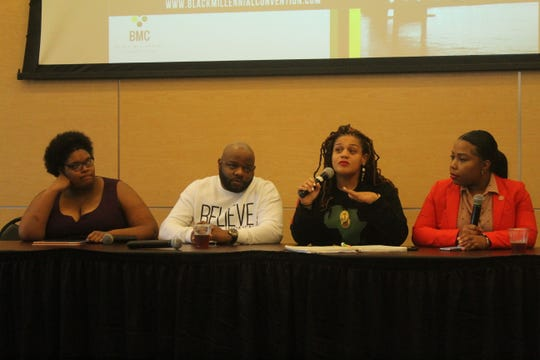 Amber Sherman (far left), Mario Giles (middle left), Evetty Satterfield (middle right) and Sen. Katrina Robinson discuss the state of black Millennials during a panel discussion inside of the National Civil Rights Museum on Saturday.
