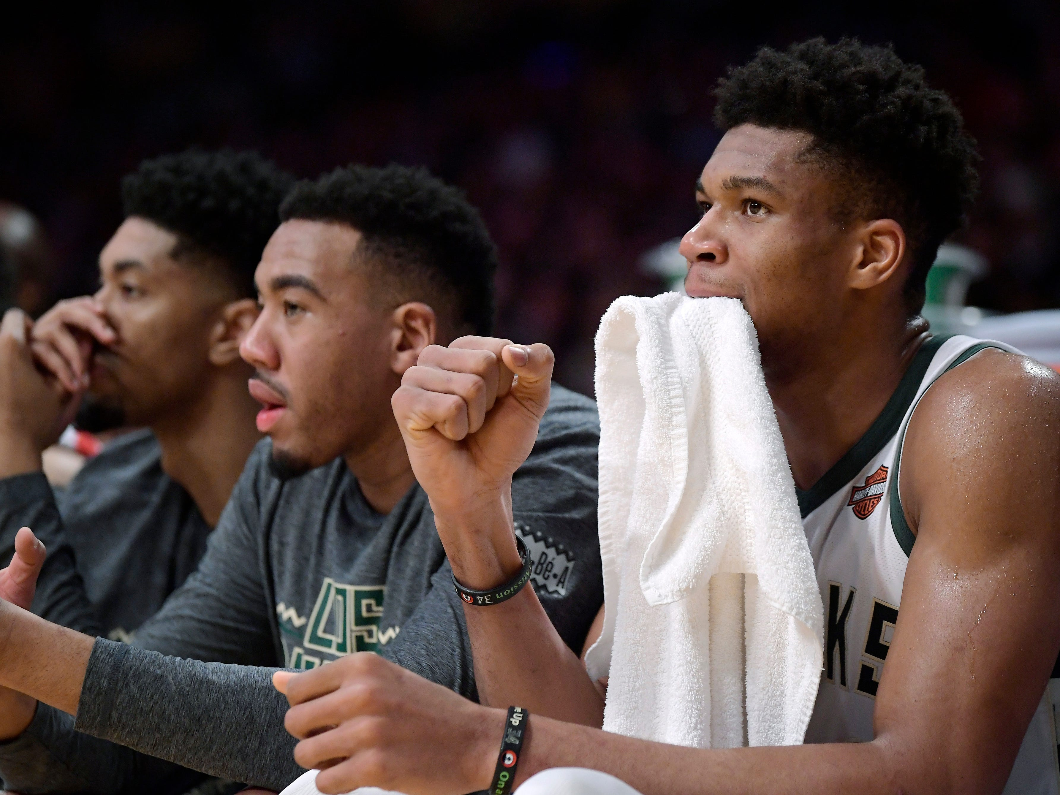 Bucks forward Giannis Antetokounmpo likes what he sees from the bench in the second half as he gets a breather against the Lakers.