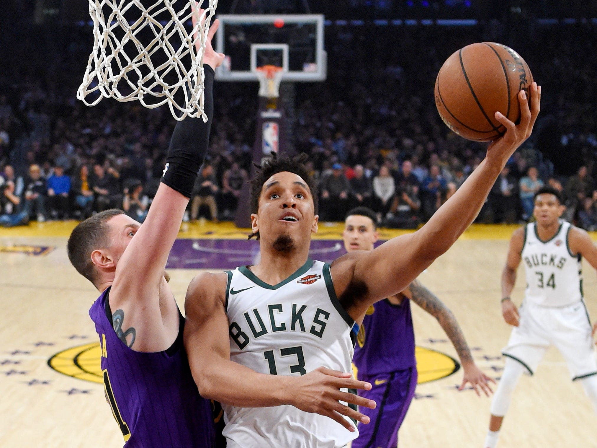 Bucks guard Malcolm Brogdon goes in for a layup against Lakers forward Mike Muscala during the first half Friday. Brogdon finished with 21 points.