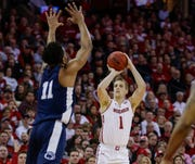 Wisconsin's Brevin Pritzl shoots a three-point basket against Penn State's Lamar Stevens on Saturday.