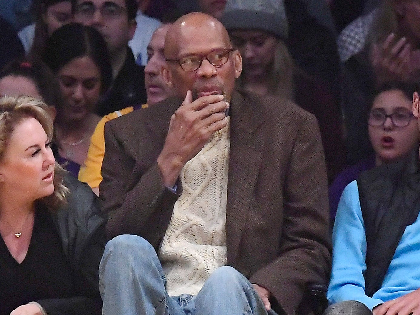 Kareem Abdul-Jabbar watches the Lakers and Bucks, his former teams, square off against each other from his courtside seat Friday night at Staples Center.
