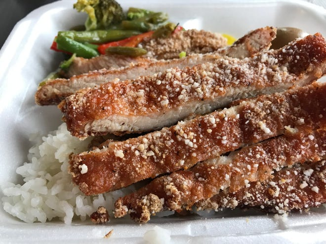 The crisp Taiwanese pork chop, served with vegetables and rice flavored with minced pork, at Bento Xpert, a new food stall at Eleven25 in the Brewery complex, 1125 N. Ninth St.