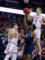 Wisconsin's Kobe King (23) and Brevin Pritzl (1) celebrate a basket against Penn State's Jamari Wheeler (5) during the second half of an NCAA college basketball game Saturday, March 2, 2019, in Madison, Wis. Wisconsin won 61-57. (AP Photo/Andy Manis) ORG XMIT: WIAM107