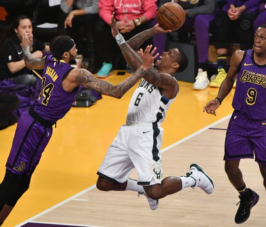Bucks guard Eric Bledsoe goes strong to the basket for two of his 31 points against the Lakers on Friday night at the Staples Center.