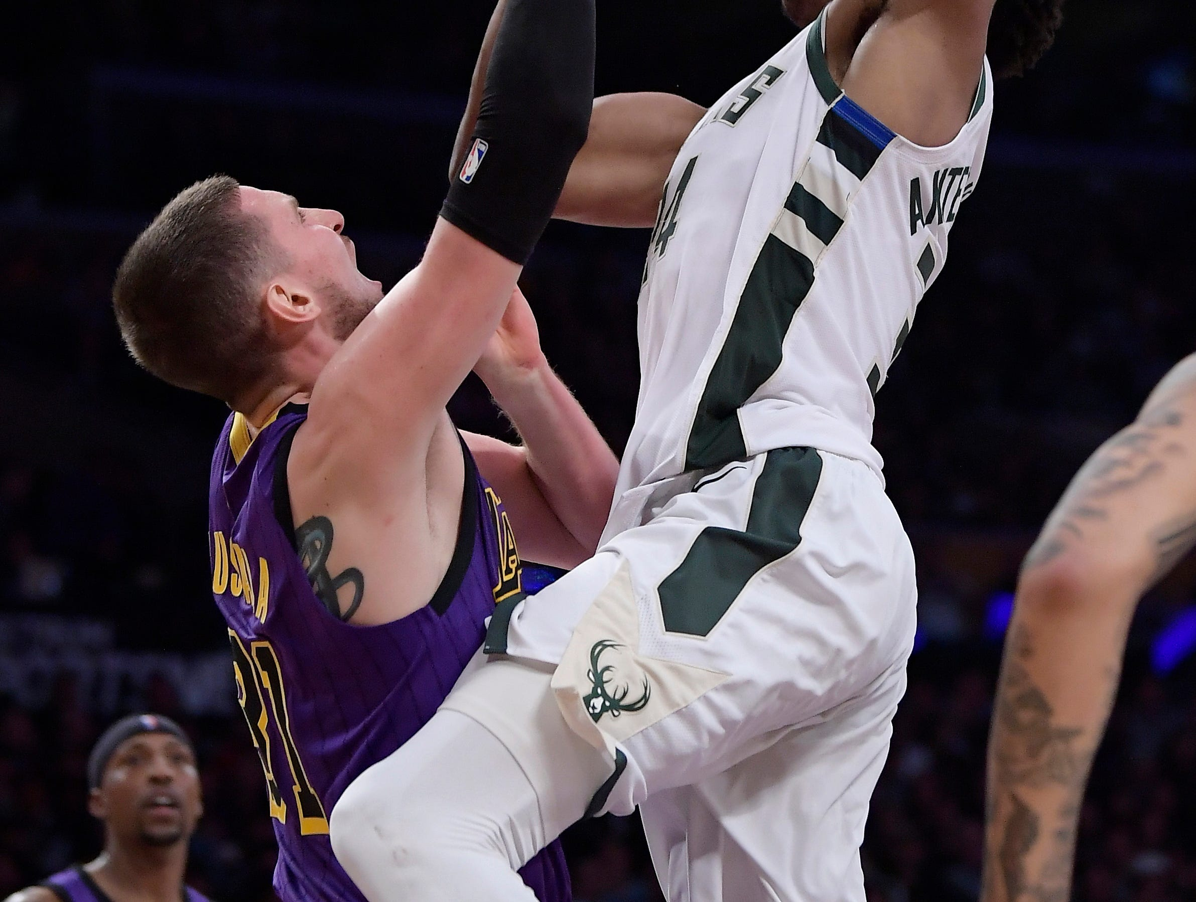 Bucks forward Giannis Antetokounmpo gets ready to hammer down a dunk and add Lakers forward Mike Muscala to his posterized collection during the second half.