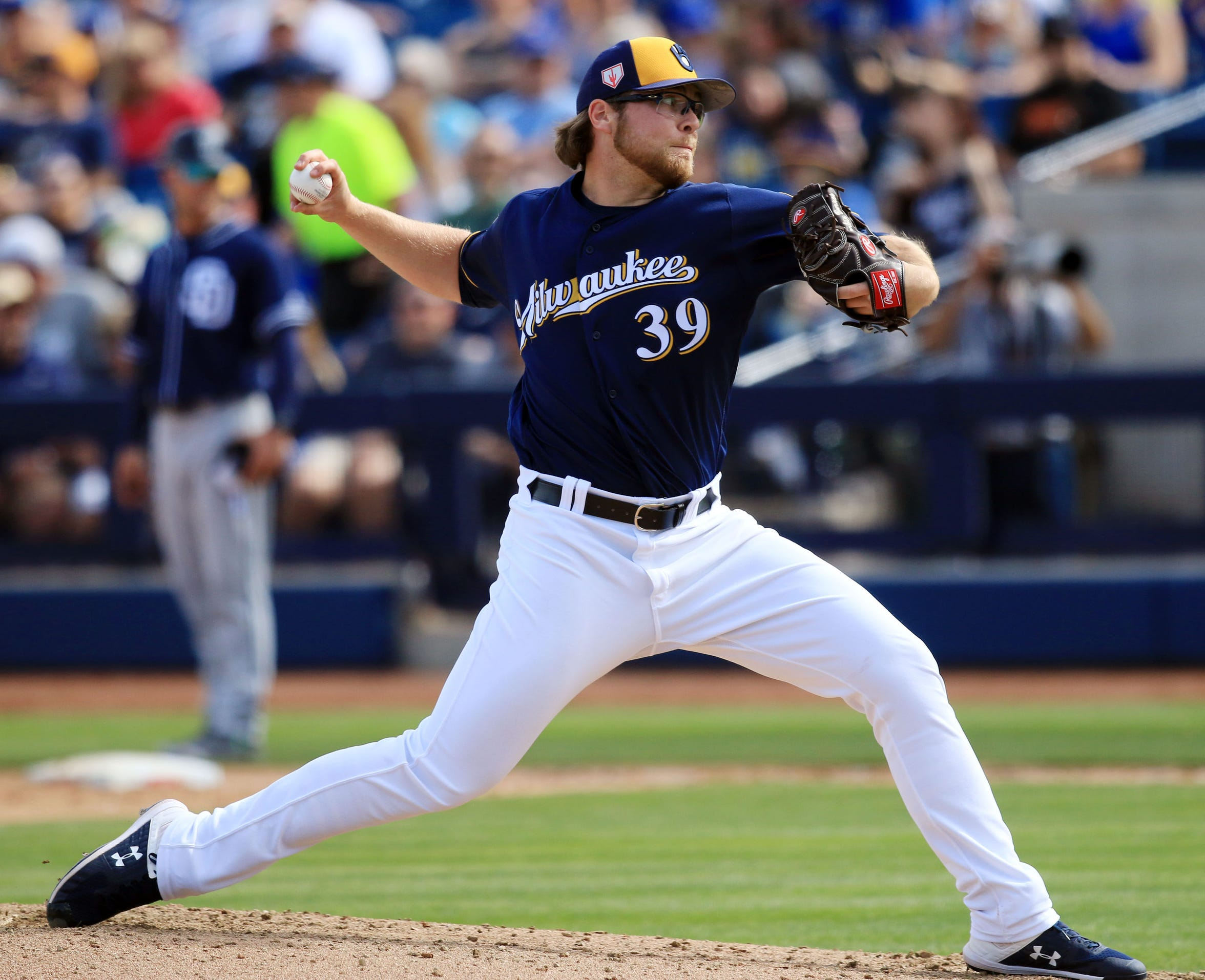 Milwaukee Brewers Corbin Burnes delivers a pitch during their spring training game against the San Diego Padres at American Family Fields of Phoenix, Tuesday, February 26, in Phoenix, Arizona.(Photo/Roy Dabner) ORG XMIT: RD076